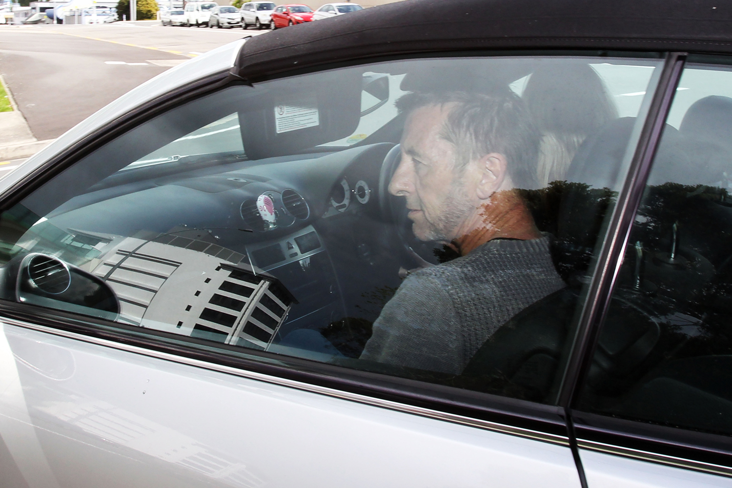 AC/DC drummer Phil Rudd leaves Tauranga District Court after being charged with attempting to procure murder on November 6, 2014 in Tauranga, New Zealand.