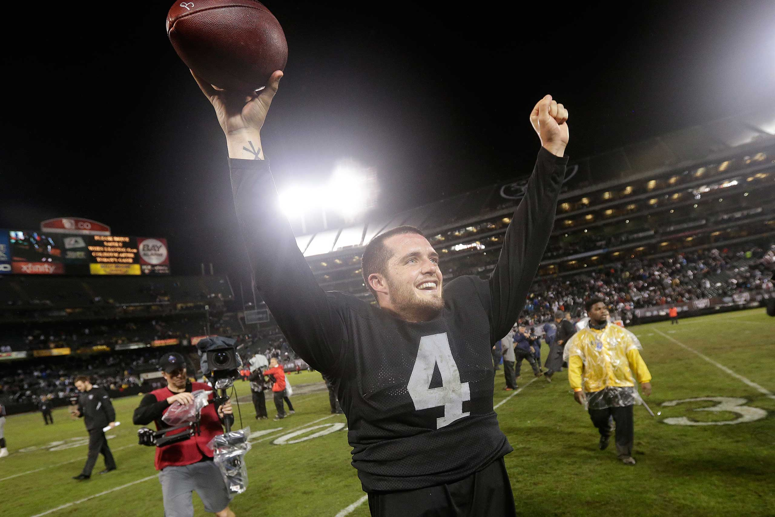Oakland Raiders quarterback Derek Carr celebrates after the Raiders defeated the Kansas City Chiefs 24-20 in an NFL football game in Oakland, Calif., Nov. 20, 2014.