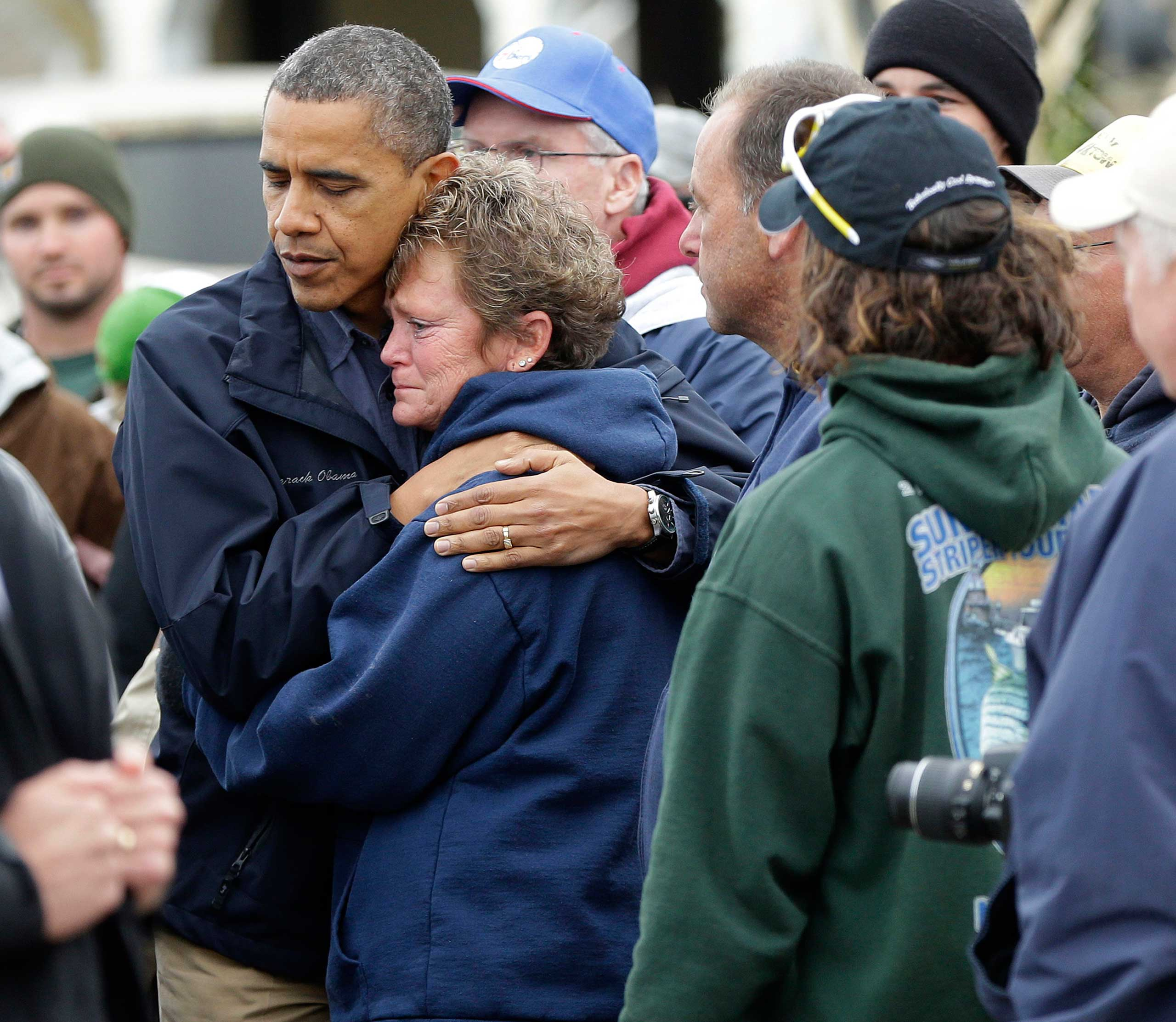 The photo of Obama hugging a victim of Hurricane Sandy went viral- his solemn face and her tear-stained one, his arms protectively around her shoulders – this is a presidential hug in its purest form.