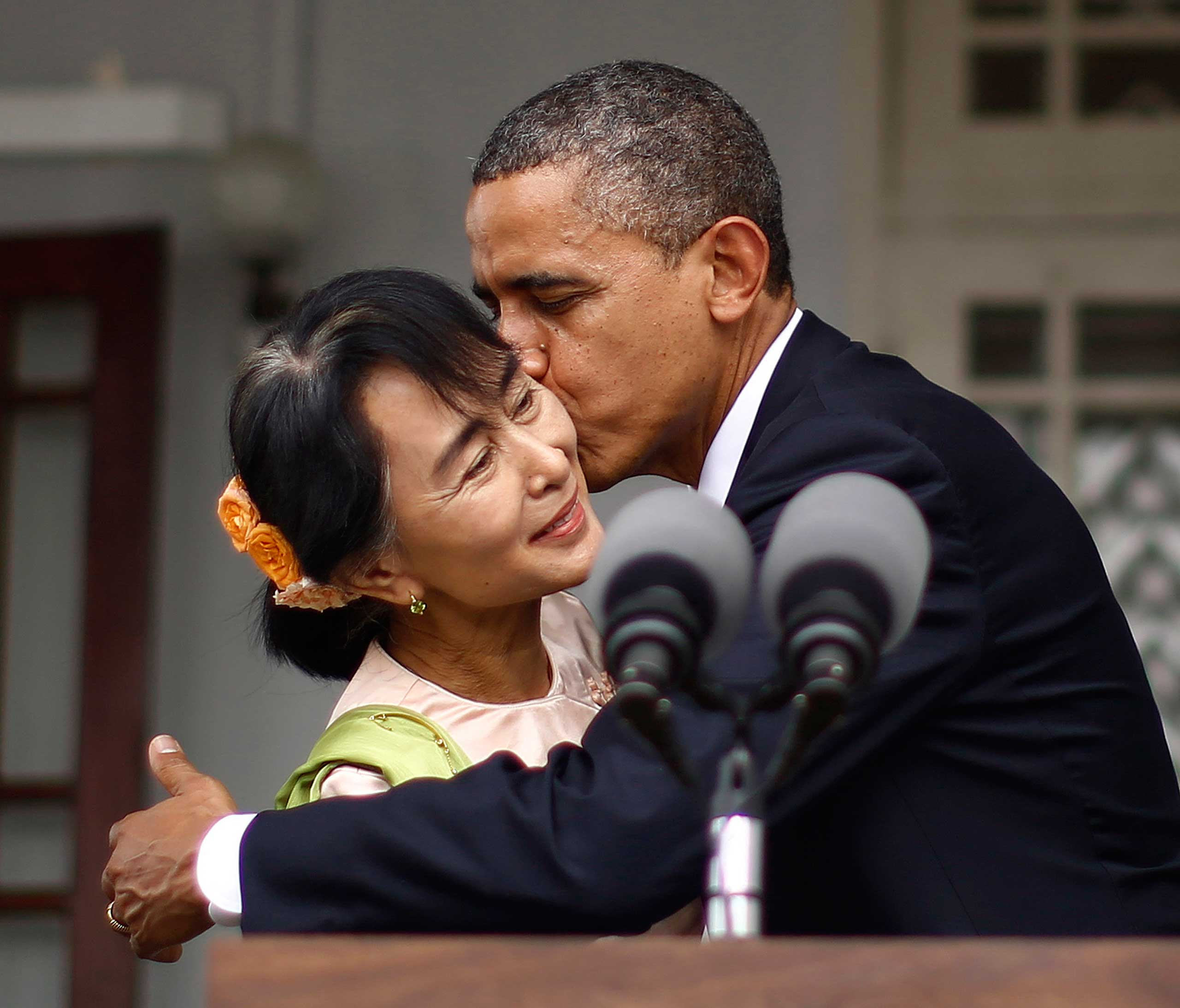 Though Obama's peck on Burmese democracy activist Aung San Suu Kyi's cheek was a pro-democracy smooch, her visible recoil from the kiss indicates that he may have been better off with a handshake.
