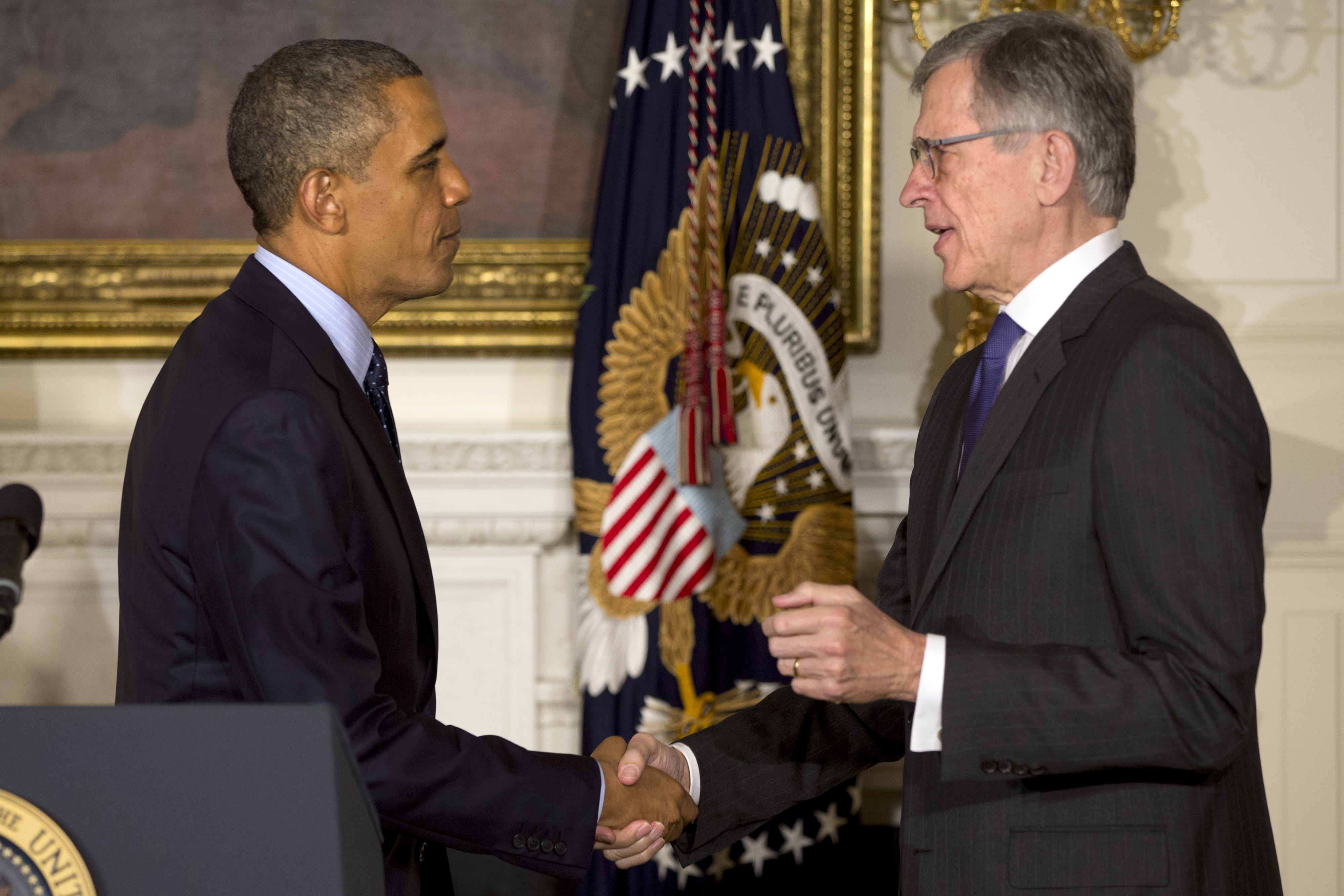 In this May 1, 2013 file photo, President Barack Obama shakes hands with then nominee for Federal Communications Commission, Tom Wheeler, in the State Dining Room of the White House in Washington.
