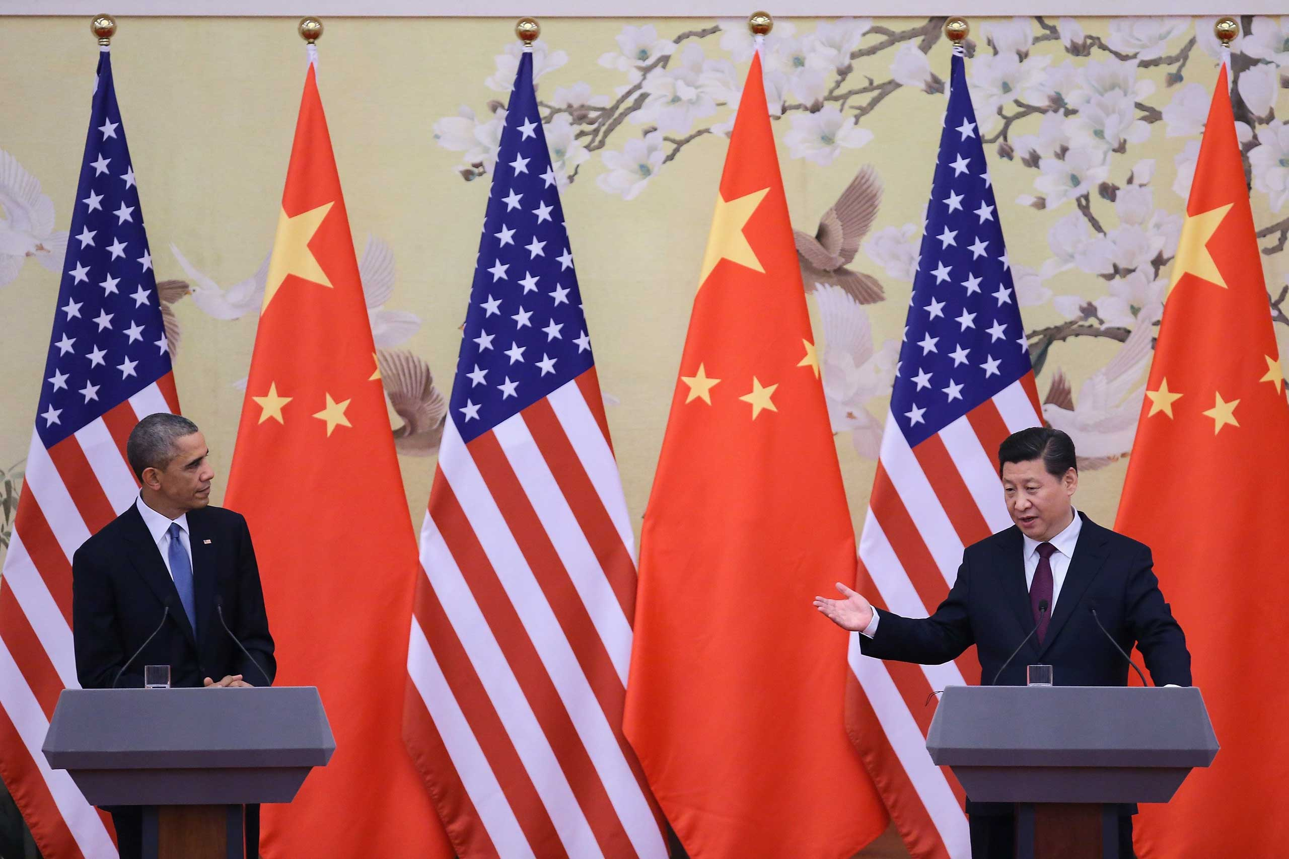 President Barack Obama and Chinese President Xi Jinping attend a press conference at the Great Hall of People on Nov. 12, 2014 in Beijing.