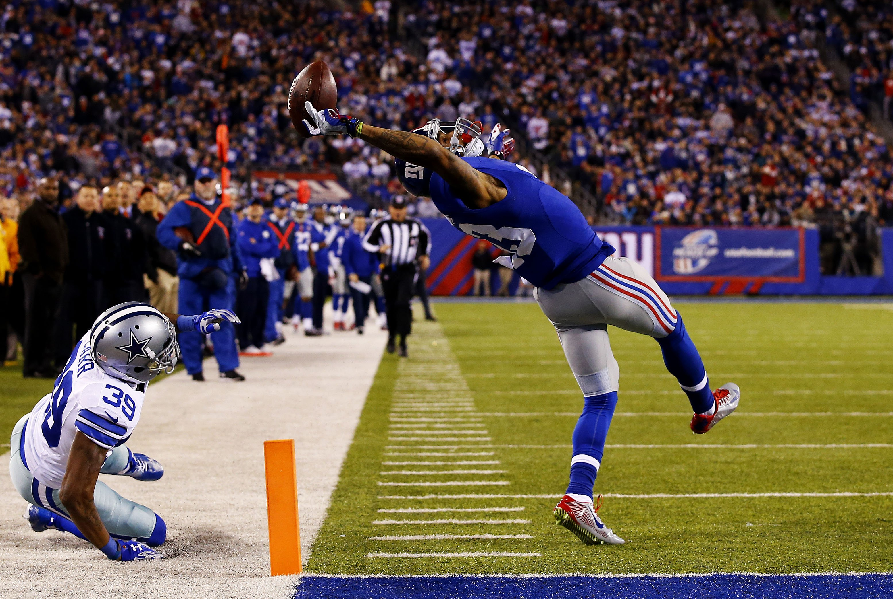 Odell Beckham #13 of the New York Giants scores a touchdown in the second quarter against the Dallas Cowboys at MetLife Stadium on Nov. 23, 2014 in East Rutherford, N.J.