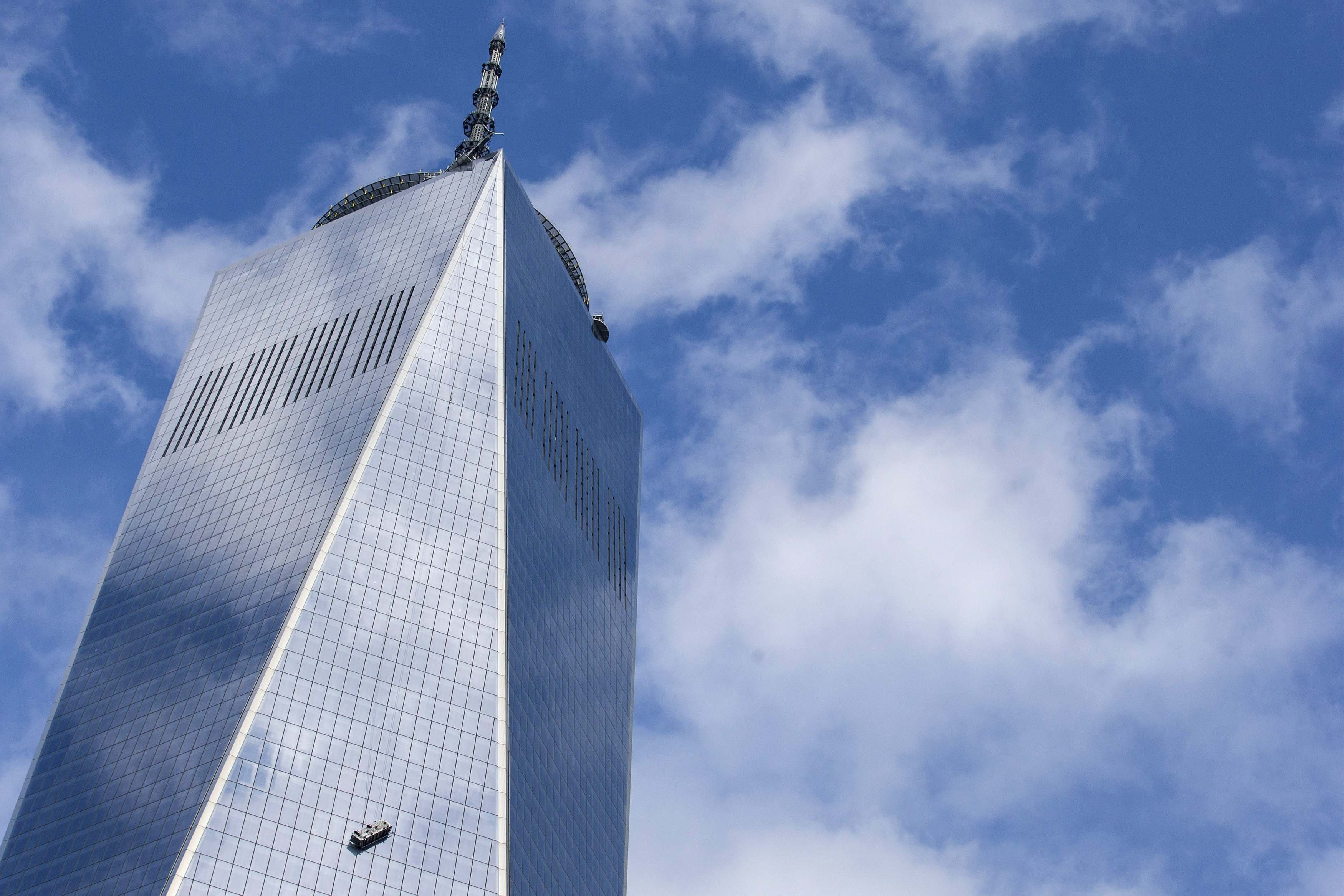 Stranded window washers hang on the side of One World Trade Center in New York on Nov. 12, 2014.