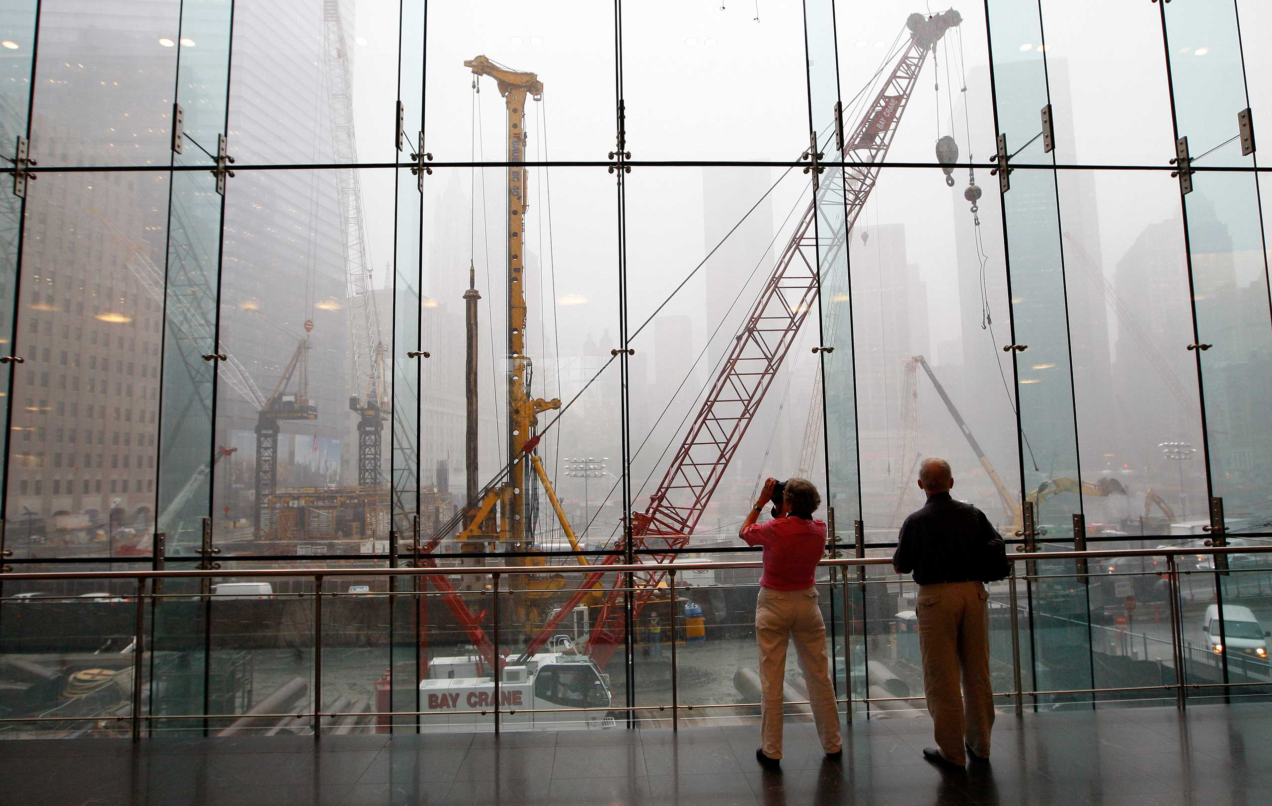 2008 Tourists look out over the World Trade Center site, two days before the seventh anniversary of the Sept. 11 attacks on Sept. 9, 2008.