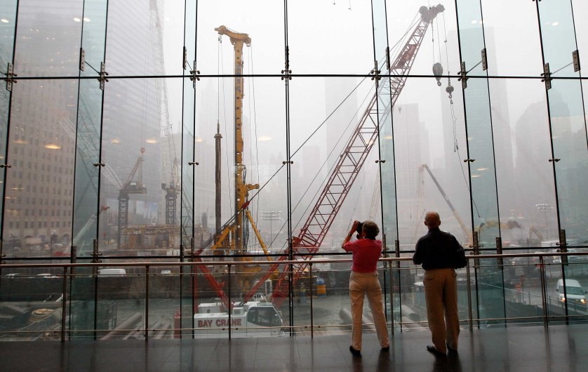 Tourists look out over the World Trade Center site, two days before the seventh anniversary of the attacks of Sept. 11, 2001 in New York on Sept. 9, 2008.