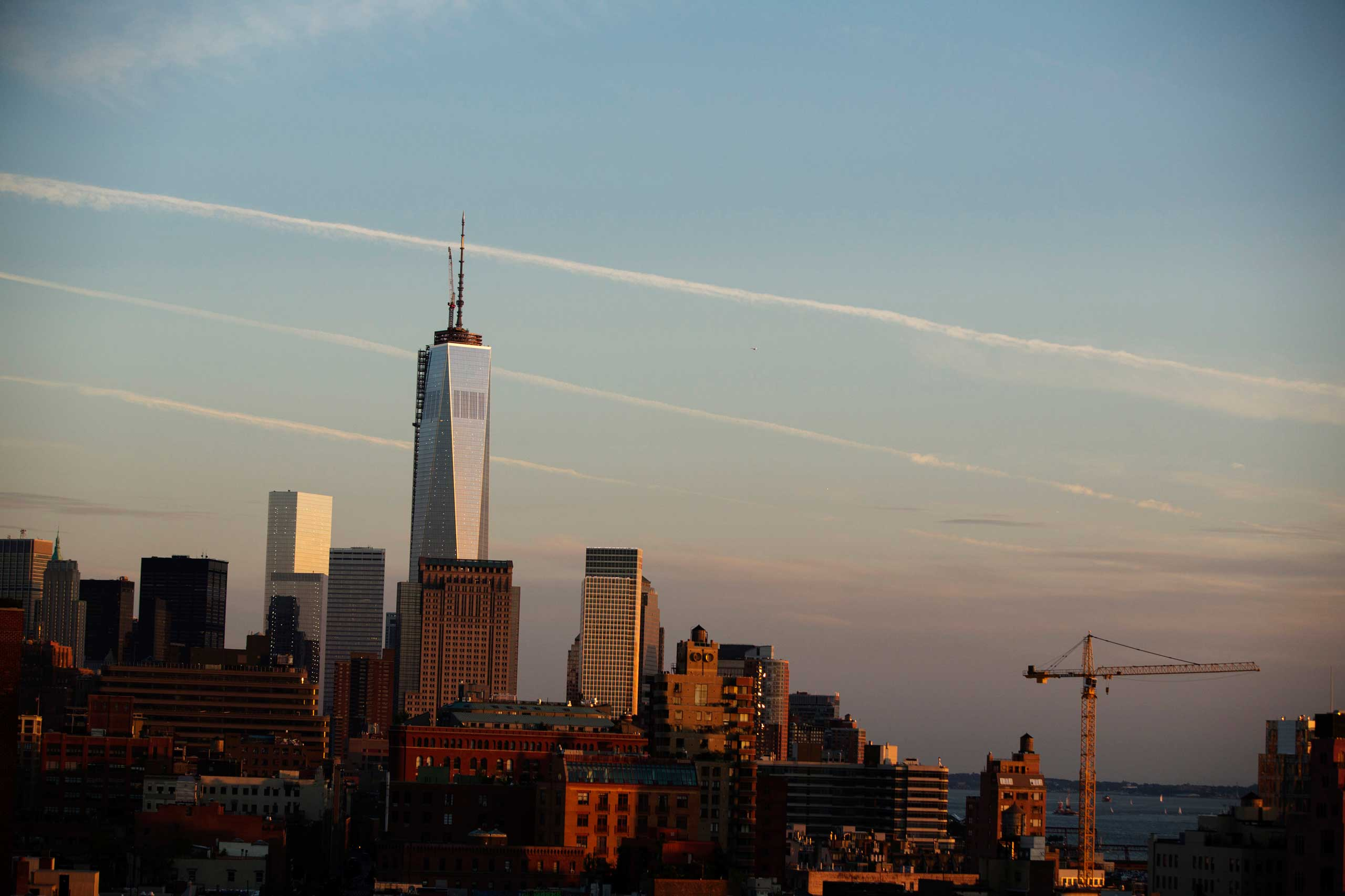 2013 One World Trade Center rises above the Manhattan skyline as seen from the pool at the Gansevoort Meatpacking NYC on June 12, 2013.