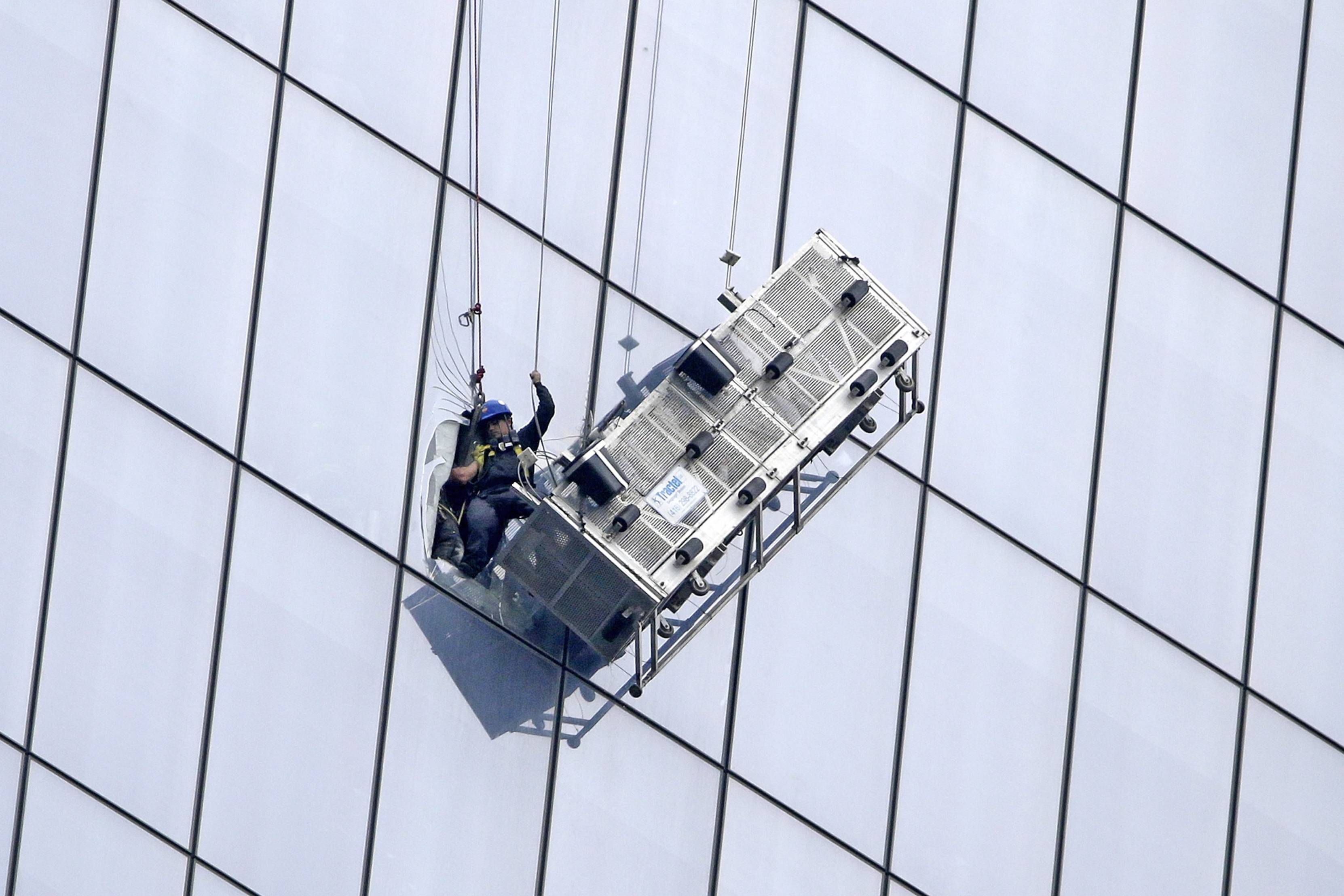 A window washer is seen being rescued by NYPD and NYFD  after his carriage came dislodged from his cables along side the One World Trade Center in New YorkCity on Nov. 12, 2014.