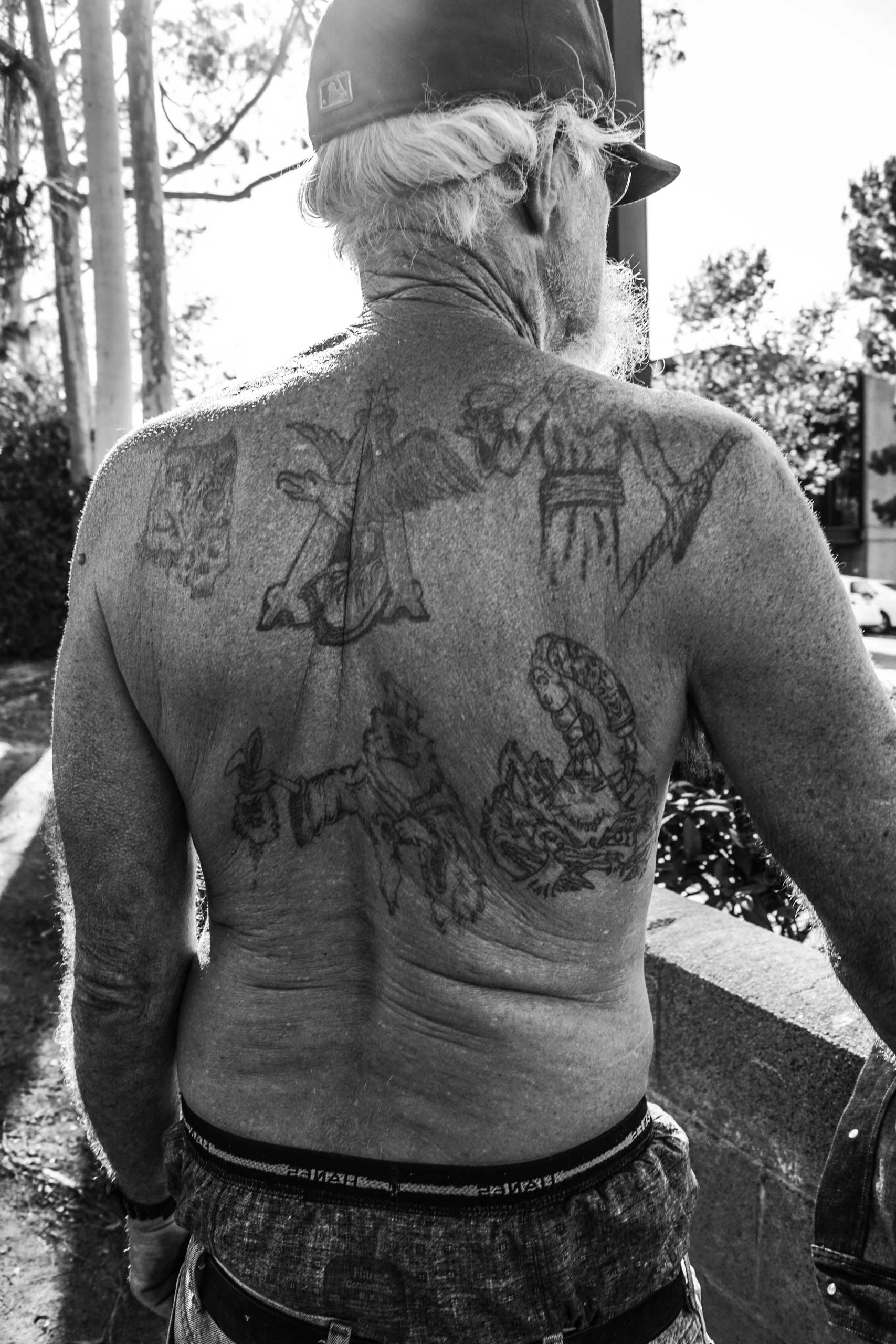 Sept. 24, 2014. Temple Street, Pomona, Calif.                                                               Levi, a homeless veteran, got his tattoos during infantry in Vietnam.  These are important to me because it tells another side of me – my past,  he told Unzueta.