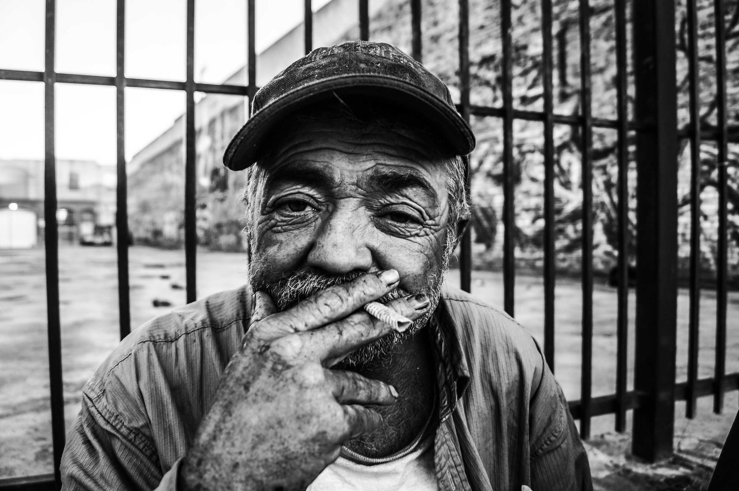 """Nov. 30, 2013. Alameda Street, Los Angeles.                                                               Originally from Detroit, James has lived in Los Angeles for over year. He served in the infantry in Vietnam for several years.  I did my time, because I had to. Once that ended I found a job, but that didn't last long. I have been homeless for 20 or so years,  he told Unzueta. """"I see a lot of positive things happening for L.A., not for me though! I'm poor."""""""