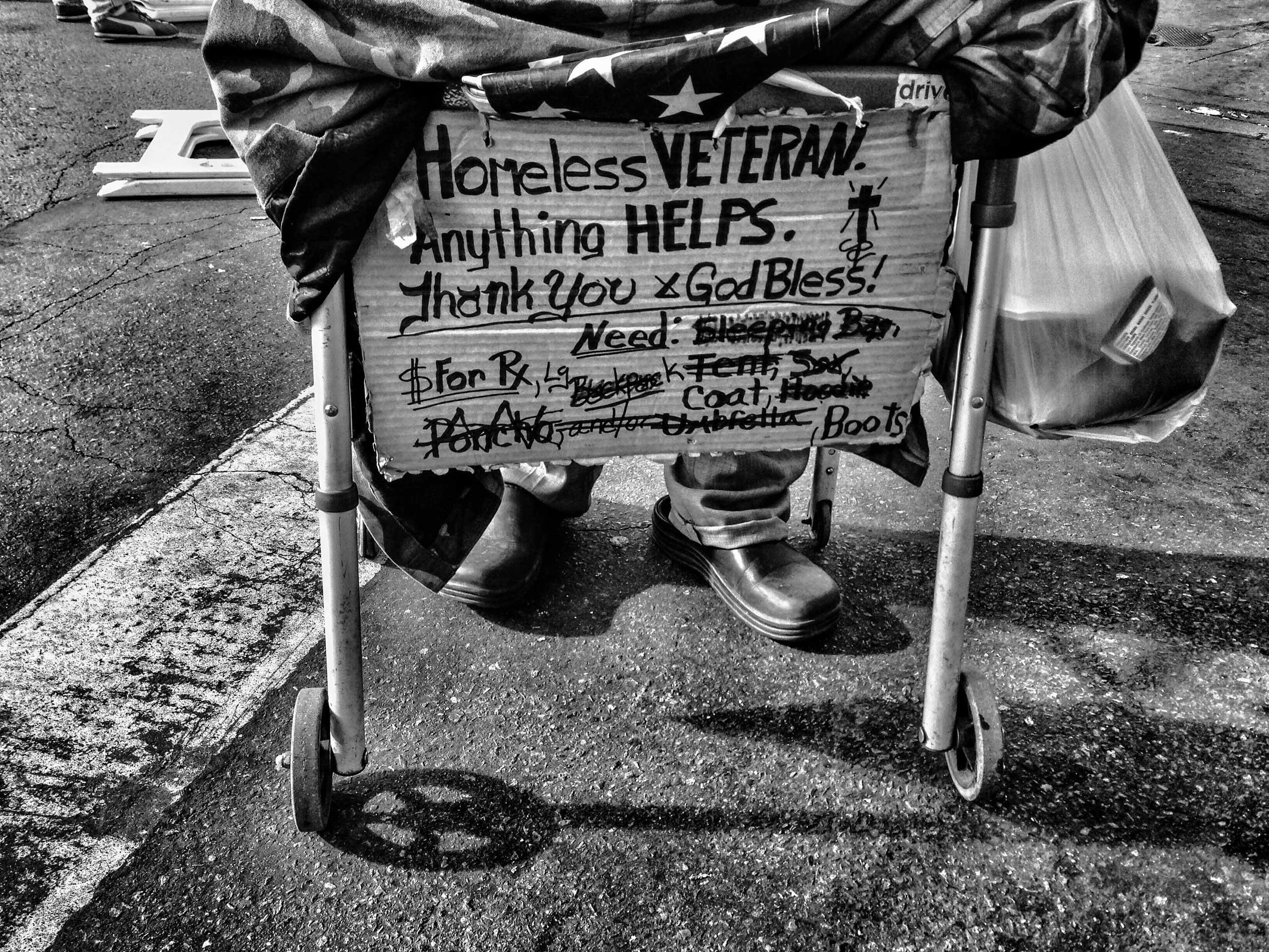 Nov. 27, 2013. San Julian Street, Los Angeles. Billy, an injured Iraq War veteran, uses a walker to help him recover from a fractured hip.