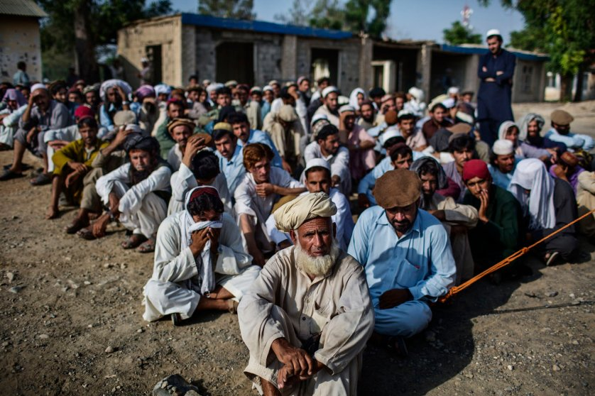 A long queue of displaced Pakistanis wait to register as refugees in Matoon, Afghanistan, a village on the outskirts of the provincial capital of Khost.