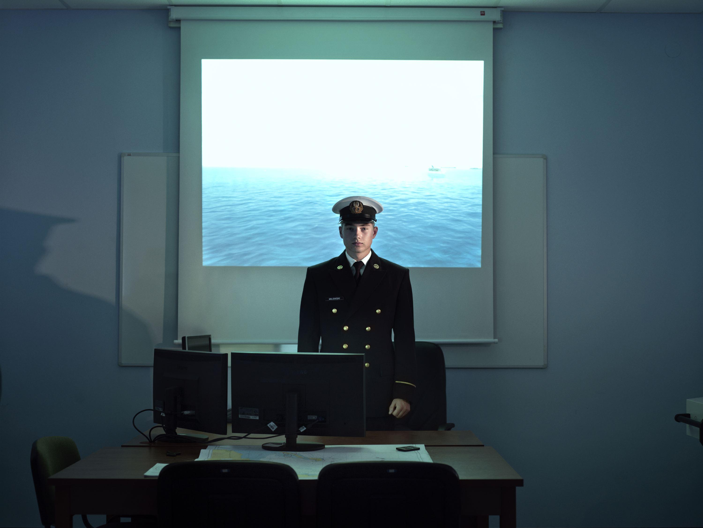 Polish Naval Academy of Gydnia (Akademia Marynarki Wojennej).                               Cadet Milewski in a training room with simulators, Gdynia, Poland, Oct. 27, 2011.