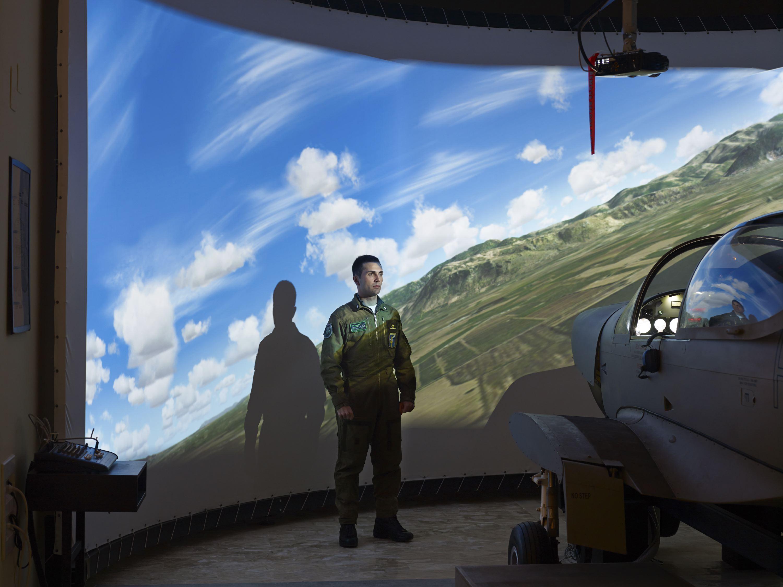 Cadet Francesco Rizzo in the flight simulator room at the Accademia Aeronautica di Pozzuoli, Pozzuoli, Italy, Dec. 20, 2014.