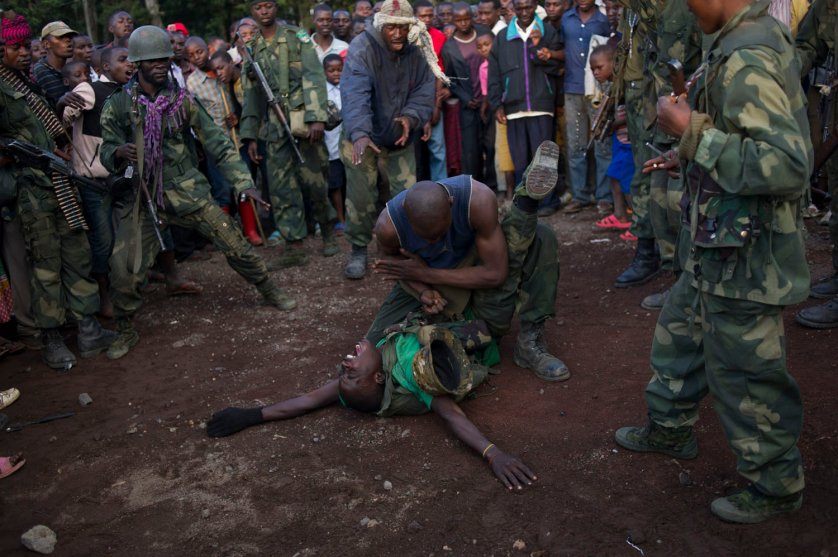 Congolese army soldiers, part of a Chinese trained commando group, celebrate with a karate demonstration following the capture of the town of Bunagana from M23 rebels in the east of the Democratic Republic of the Congo on October 30, 2013. The army took the major border town just an hour earlier, representing a major blow to the rebels.