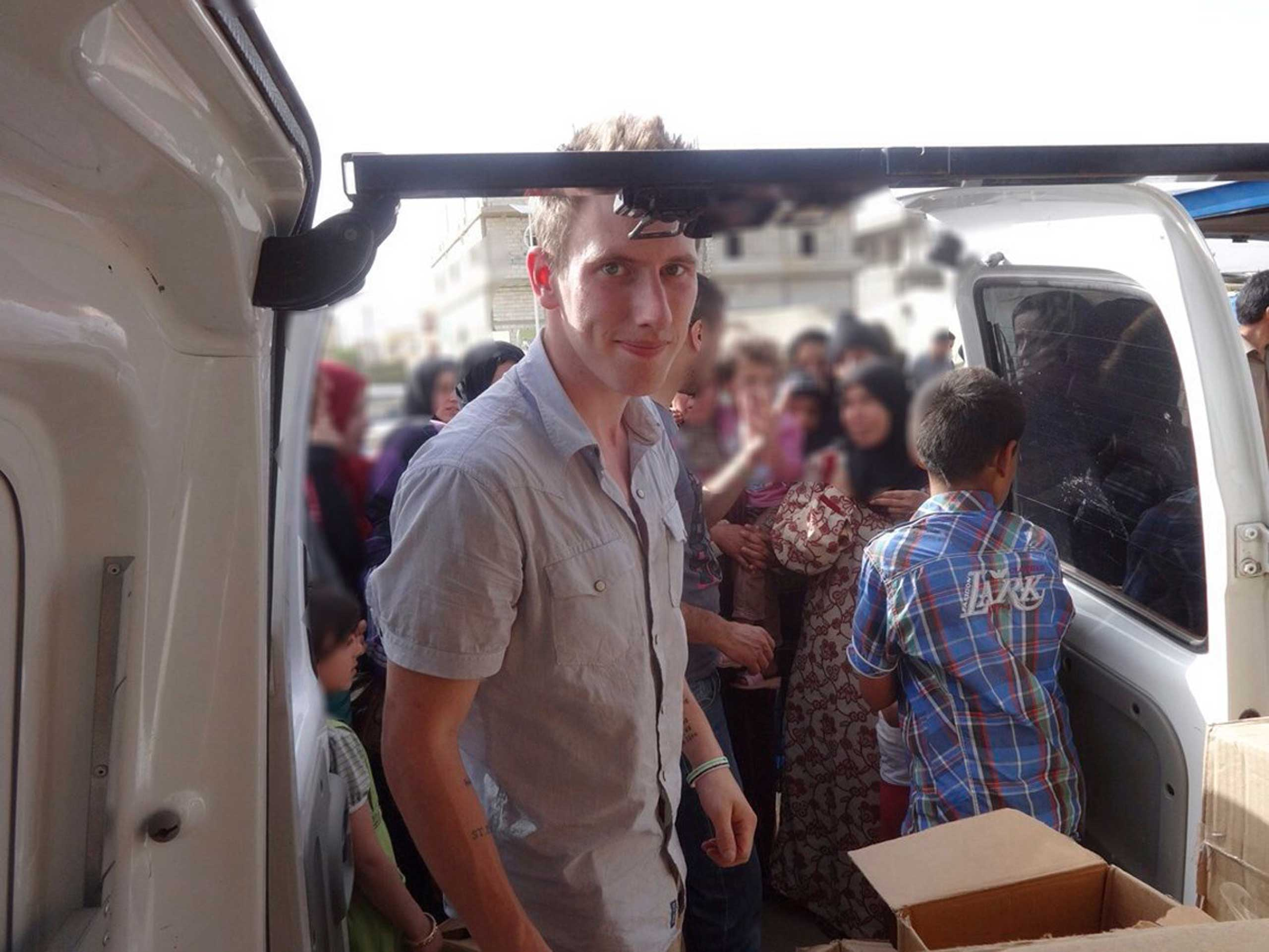 Abdul-Rahman (Peter) Kassig is pictured making a food delivery to refugees in Lebanonís Bekaa Valley in this May 2013 handout photo.