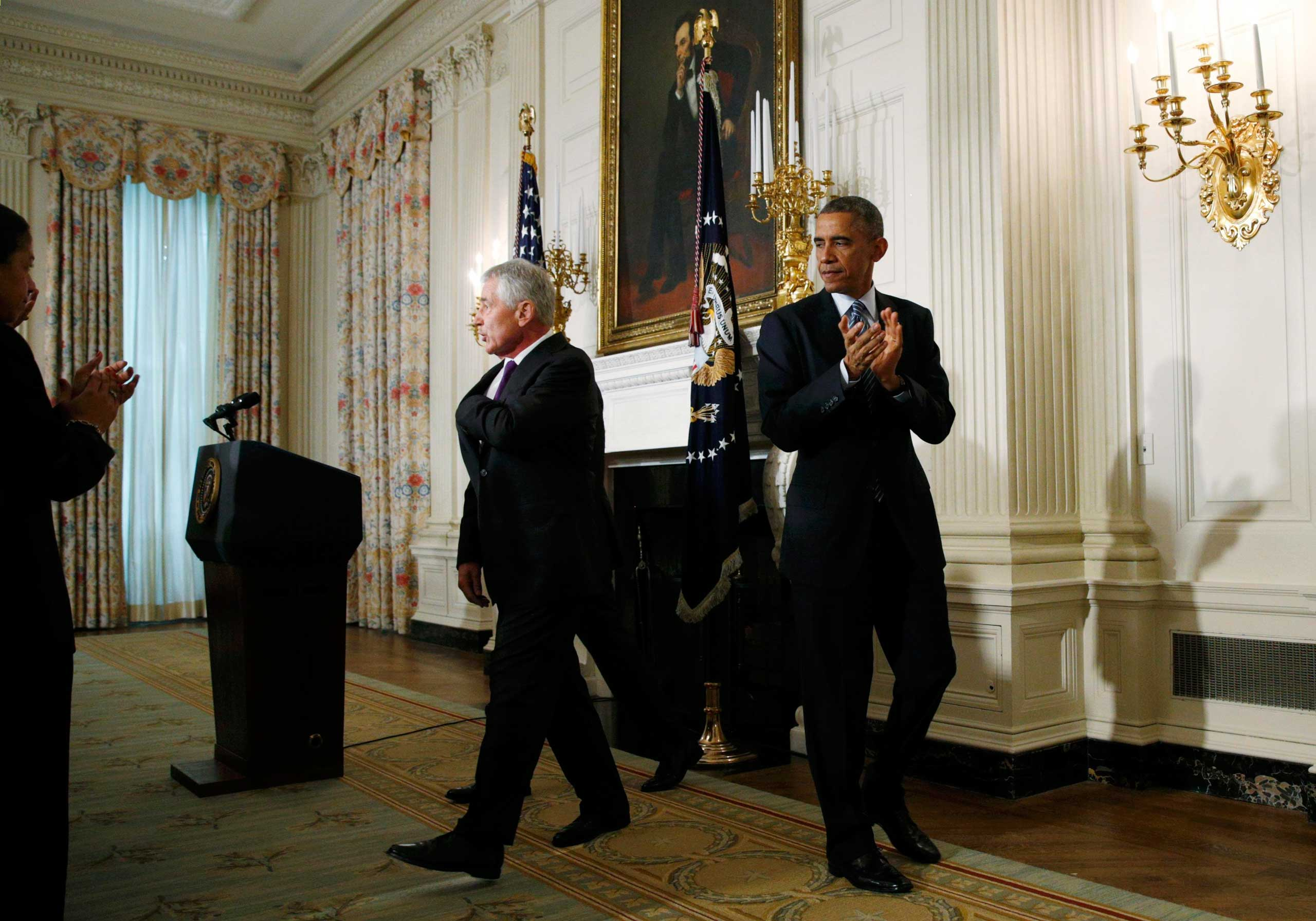 Nov. 24, 2014. U.S. President Barack Obama escorts Secretary of Defense Chuck Hagel out of the state dining room after the men announced Hagel's resignation at the White House in Washington, D.C.