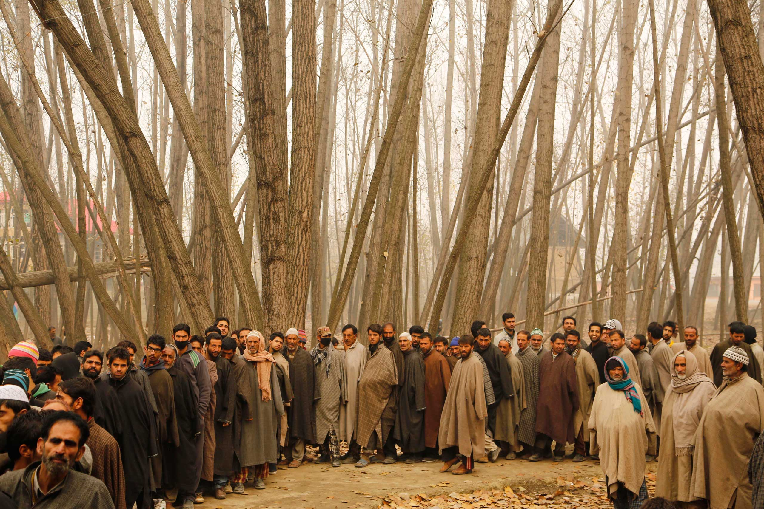 Nov. 25, 2014. Kashmiris queue to cast their votes outside a polling station during the first phase of voting to the Jammu and Kashmir state assembly elections in Shadipora, outskirts of Srinagar in the Indian controlled Kashmir. Thousands lined up to cast their votes amid a boycott call by Muslim separatist groups who reject India's sovereignty over the disputed Himalayan region.