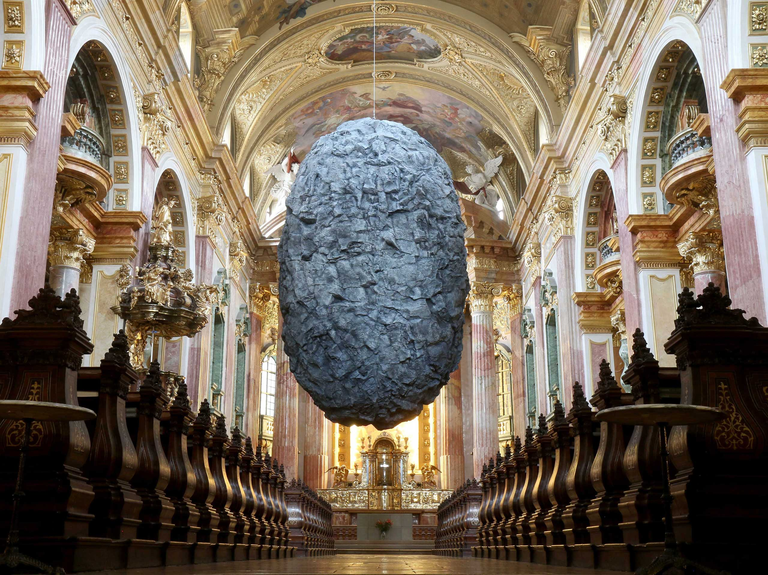 Nov. 25, 2014. A boulder plastic made of synthetic material called To be in Limbo hangs from the ceiling of the 66 ft. high Jesuit Church in Vienna. The sculpture from the artists group Steinbrener/Dempf and Huber is to symbolize faith and its threatening moments.