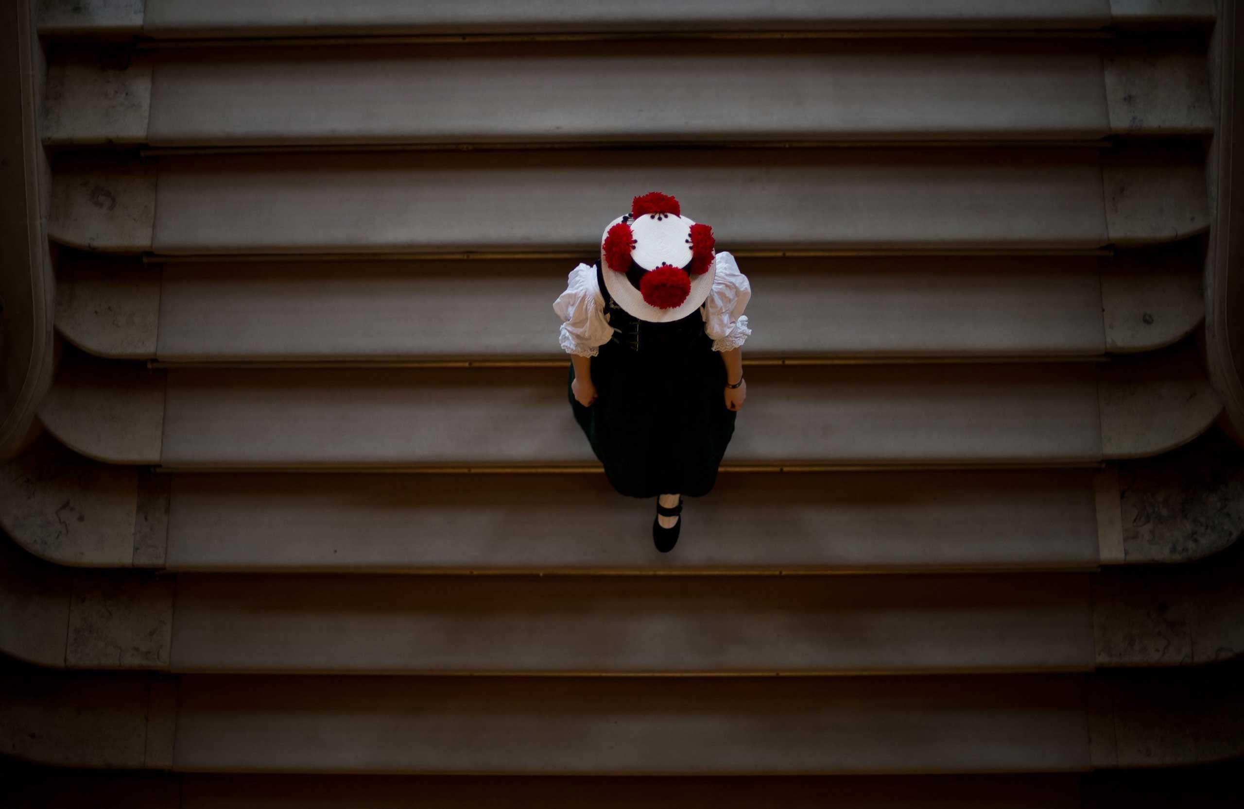 Nov. 26, 2014. A woman from the Trachten (traditional costume) Association St. Georgen in the Black Forest descends stairs during a reception held by the state government in Stuttgart, Germany,