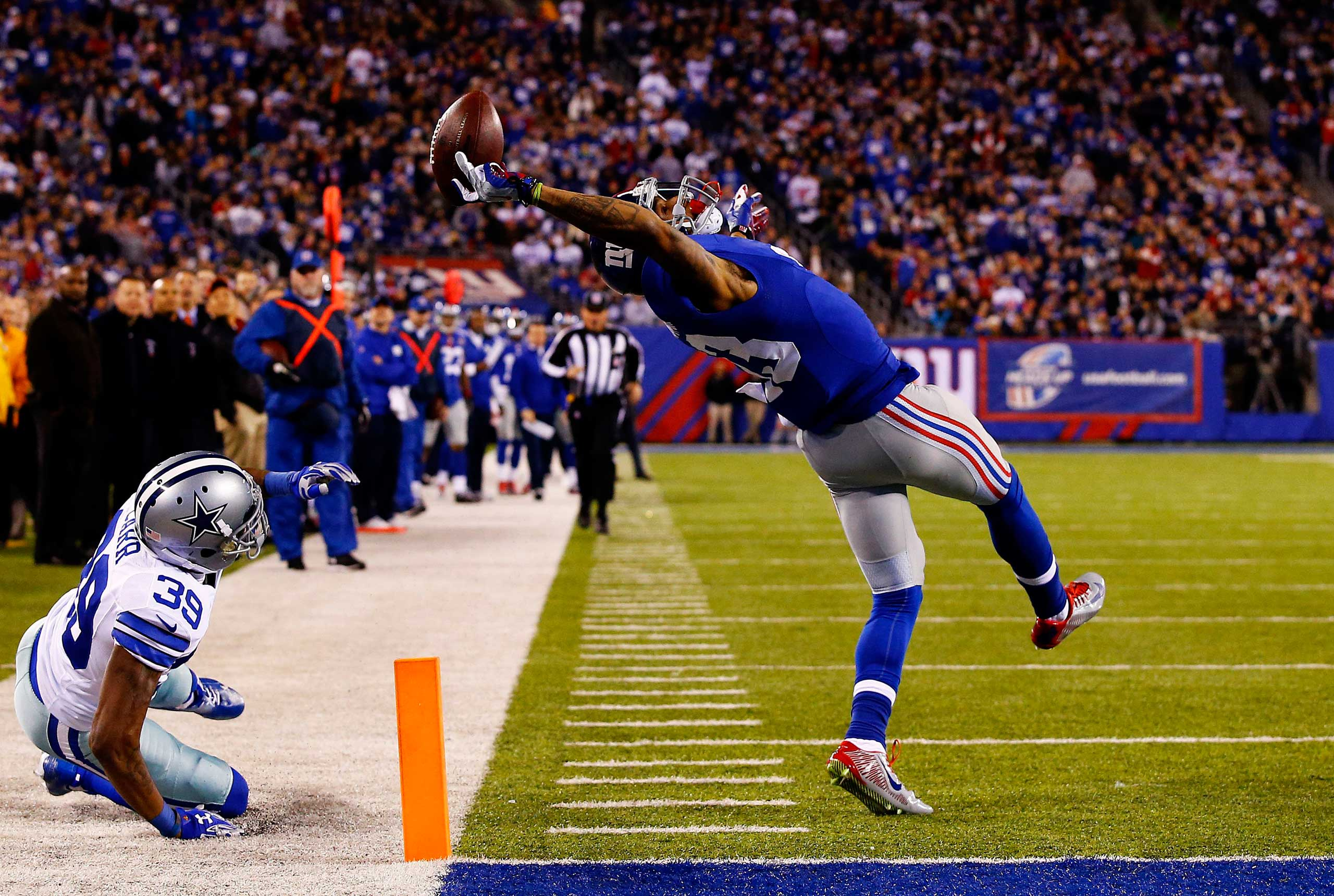 Nov. 23, 2014. Odell Beckham #13 of the New York Giants scores a touchdown in the second quarter against the Dallas Cowboys at MetLife Stadium  in East Rutherford, New Jersey.