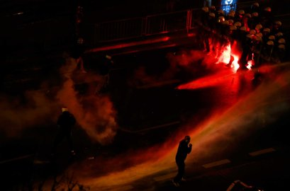 Police use water cannon to push back several hundred masked men who broke away from a far-right march and threw stones and flares at lines of riot police in Warsaw