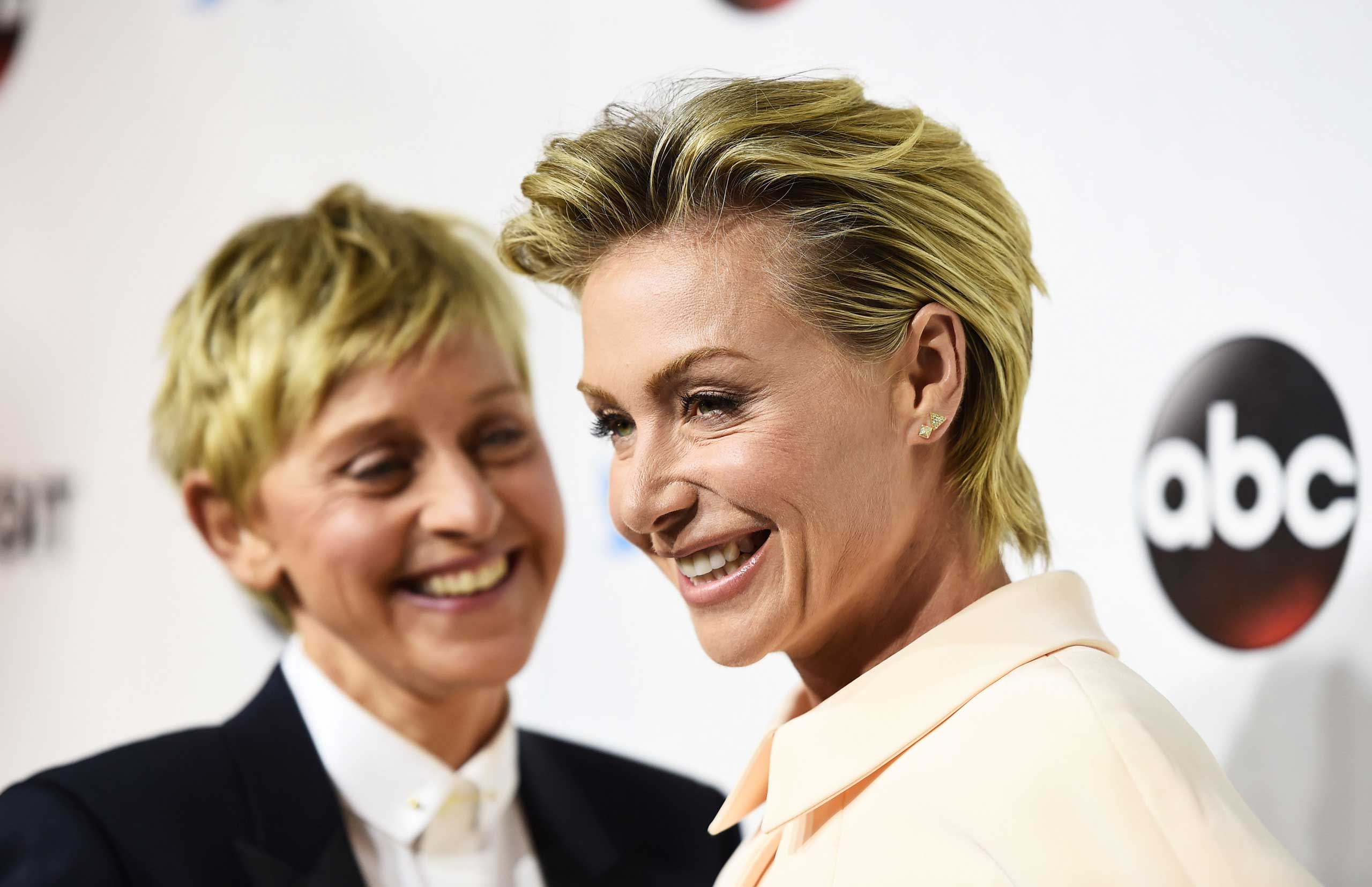 DeGeneres (L) and actress Portia de Rossi arrive at the #TGIT Premiere Event hosted by Twitter at Palihouse Holloway in West Hollywood, Calif. on Sept. 20, 2014.
