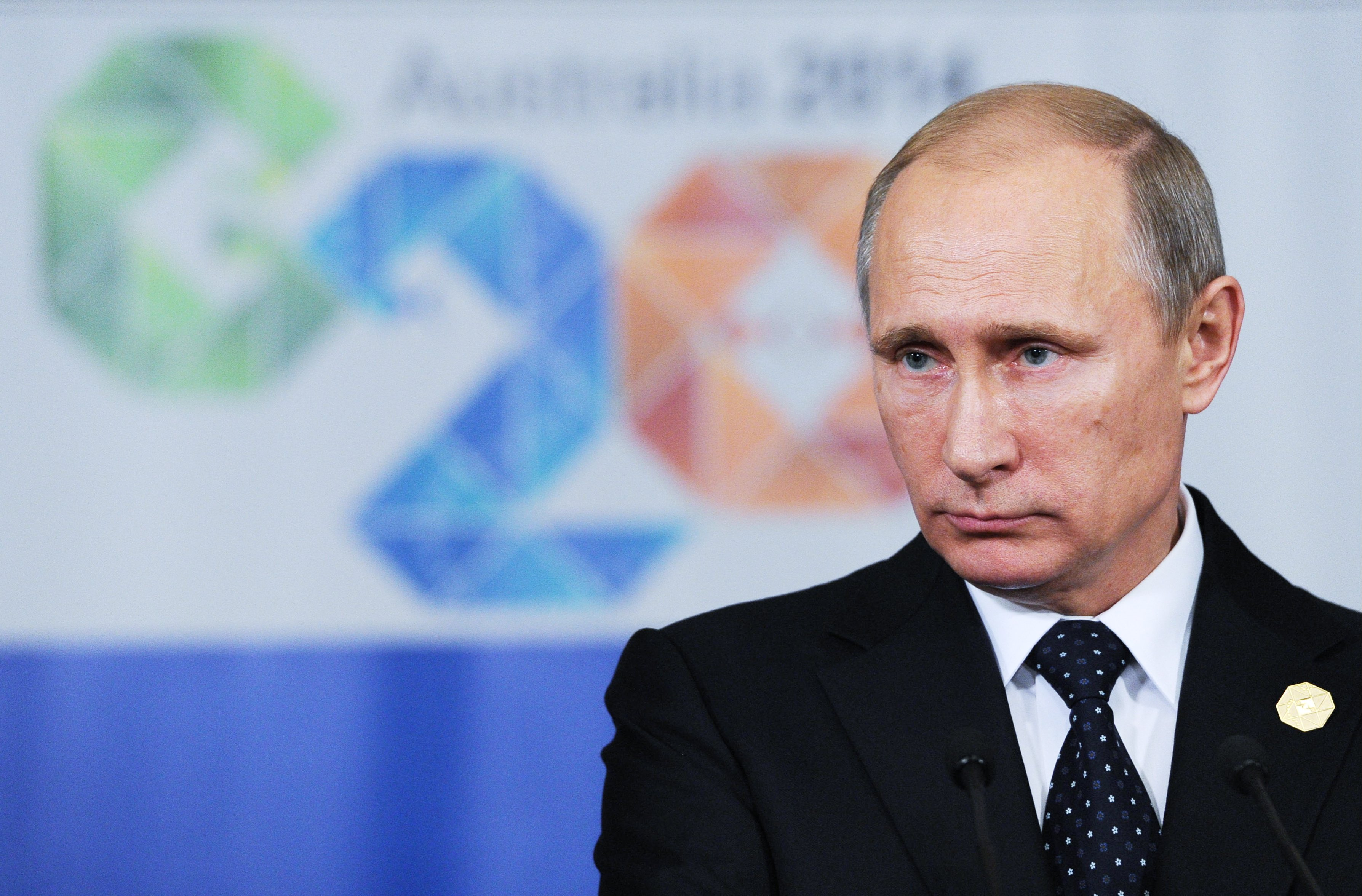 Russia's President Vladimir Putin looks on at a press conference following the G20 Leaders' Summit in Brisbane, Australia.