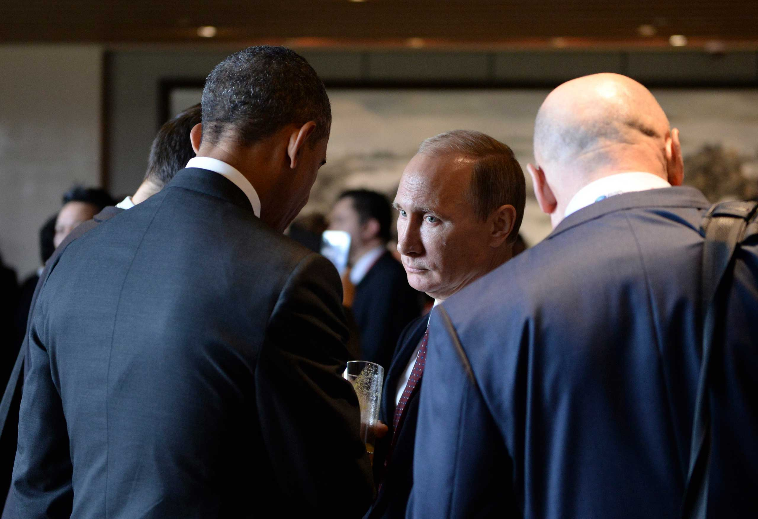 Russian President Vladimir Putin seen talking to President Barack Obama during the Asia Pacific Economic Cooperation Summit in Beijing, Nov. 11, 2014.
