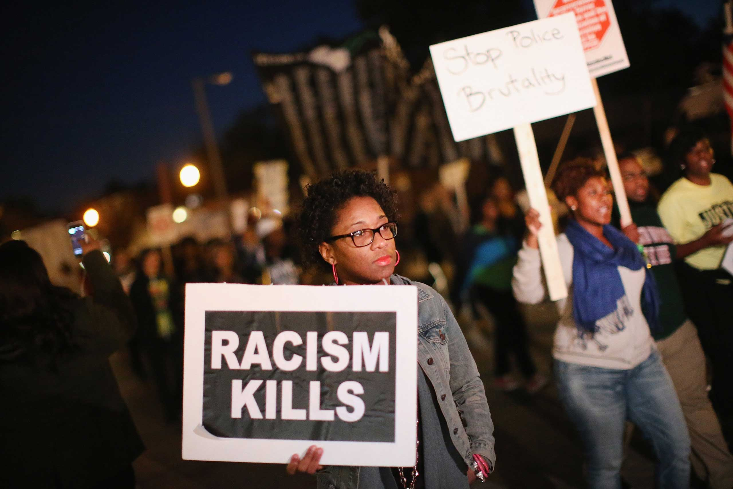 Demonstrators march toward the police station as protests continue in the wake of 18-year-old Michael Brown's death on Oct. 22, 2014 in Ferguson, Mo.