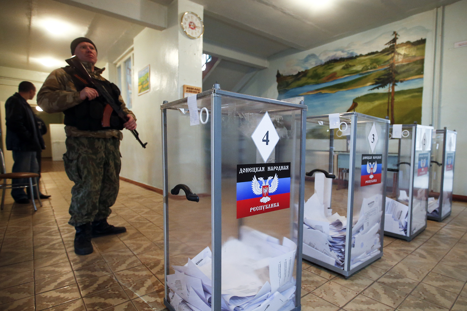 A pro-Russian separatist stands guard during the self-proclaimed Donetsk People's Republic leadership and local parliamentary elections at a polling station near Donetsk on Nov. 2, 2014