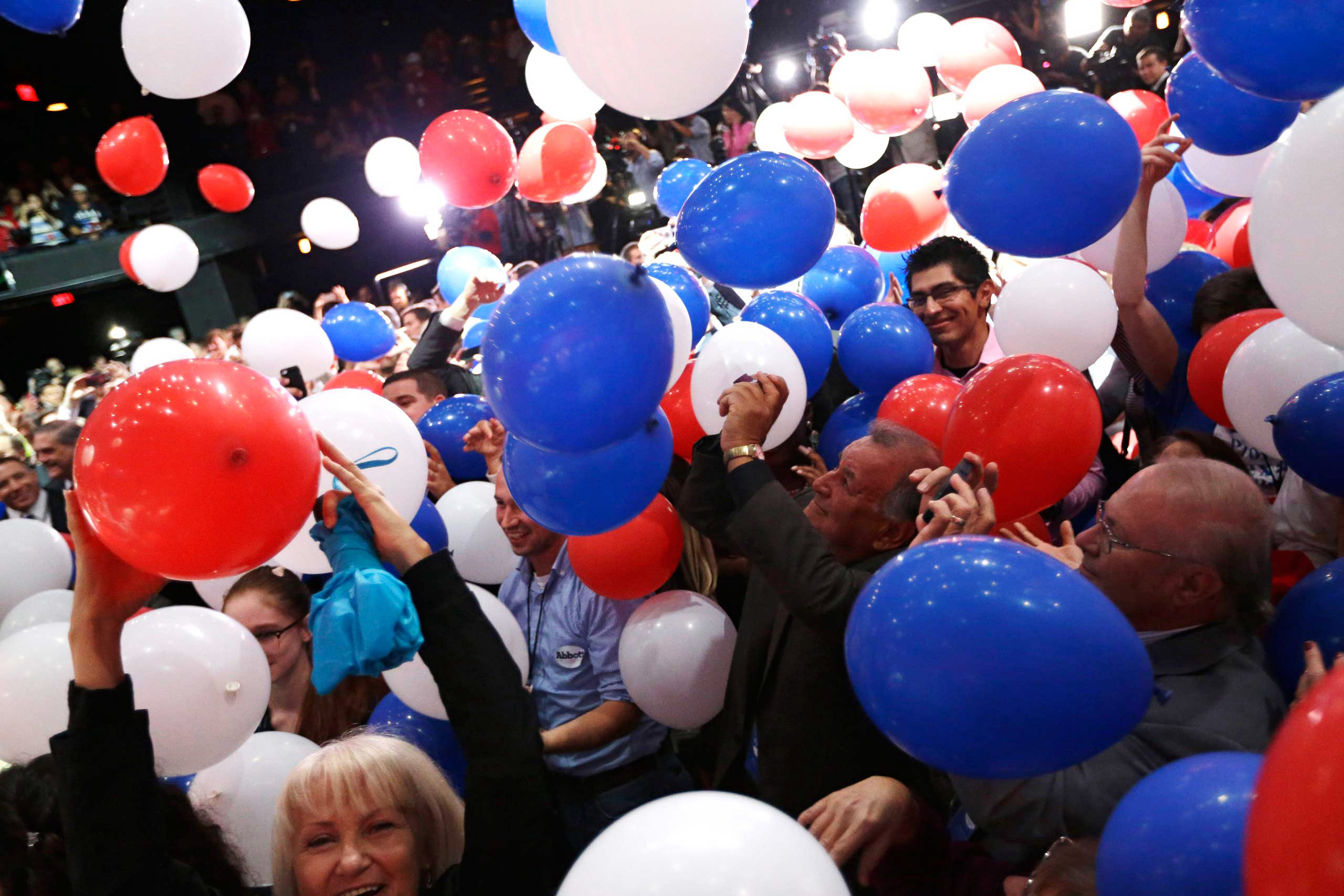Supporters cheer as balloons fall after Texas Attorney General and Republican candidate for governor Greg Abbott's victory speech in Austin on Nov. 4, 2014.