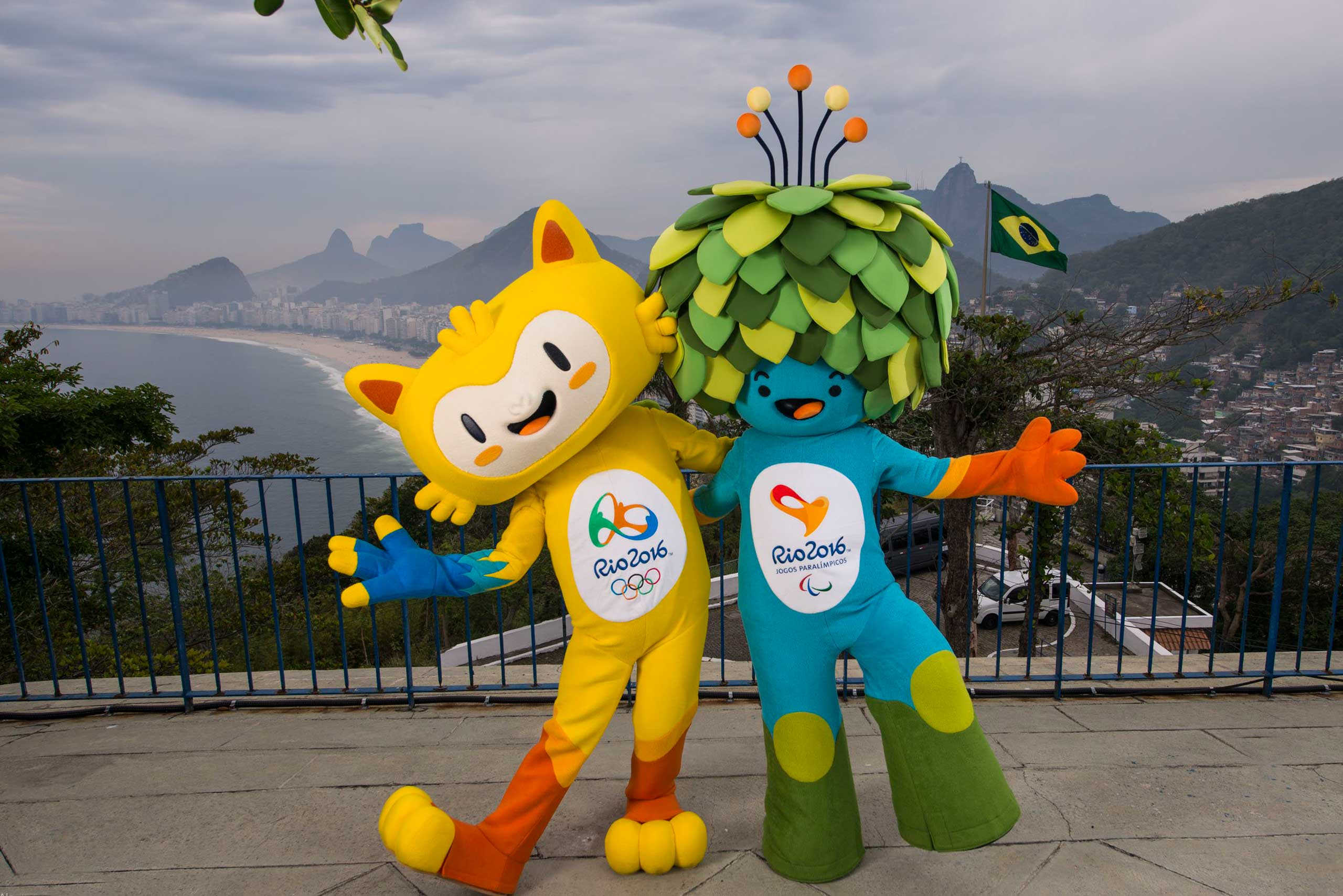 The mascots of the Rio 2016 Olympic and Paralympic Games are pictured in front of the Copacabana beach during their first appearance in Rio de Janeiro, Nov.23, 2014.