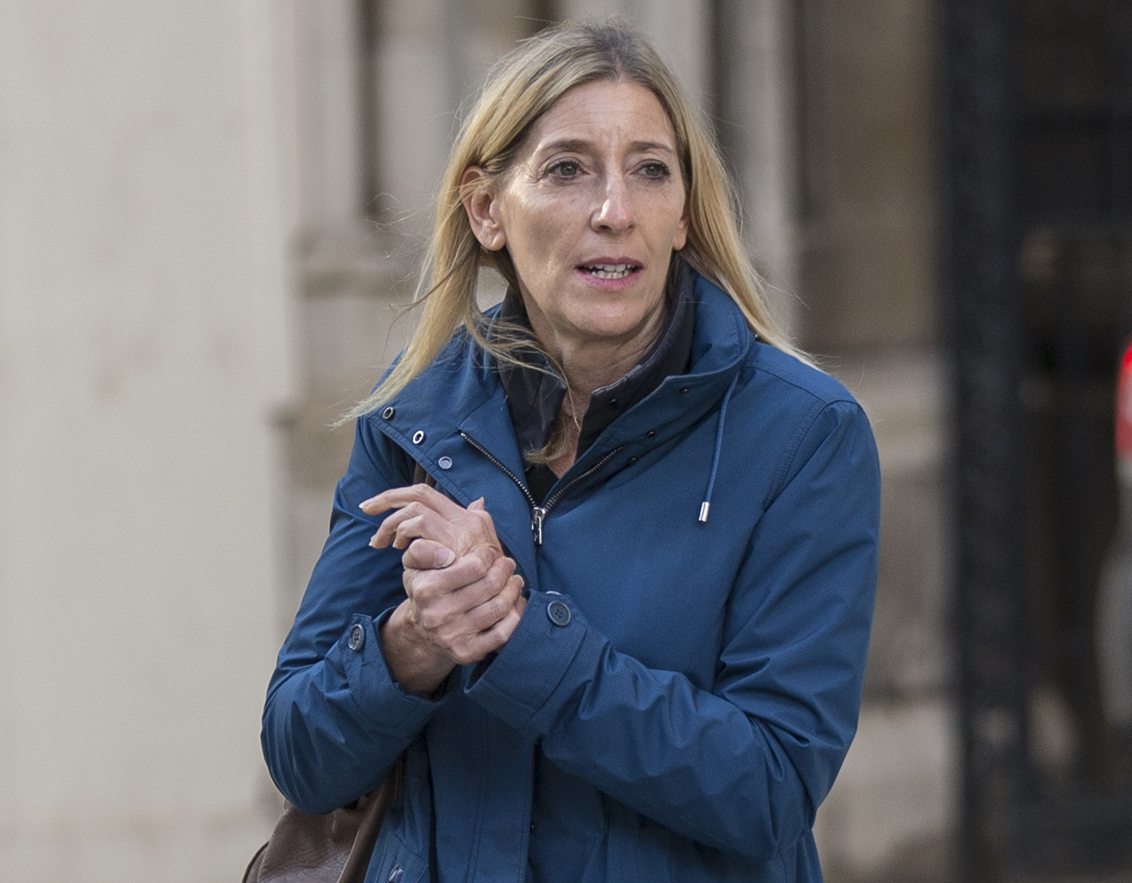 Jamie Cooper-Hohn, wife of top hedge-fund boss Chris Hohn, leaves the High Court after a divorce hearing, in central London on Oct. 10, 2014