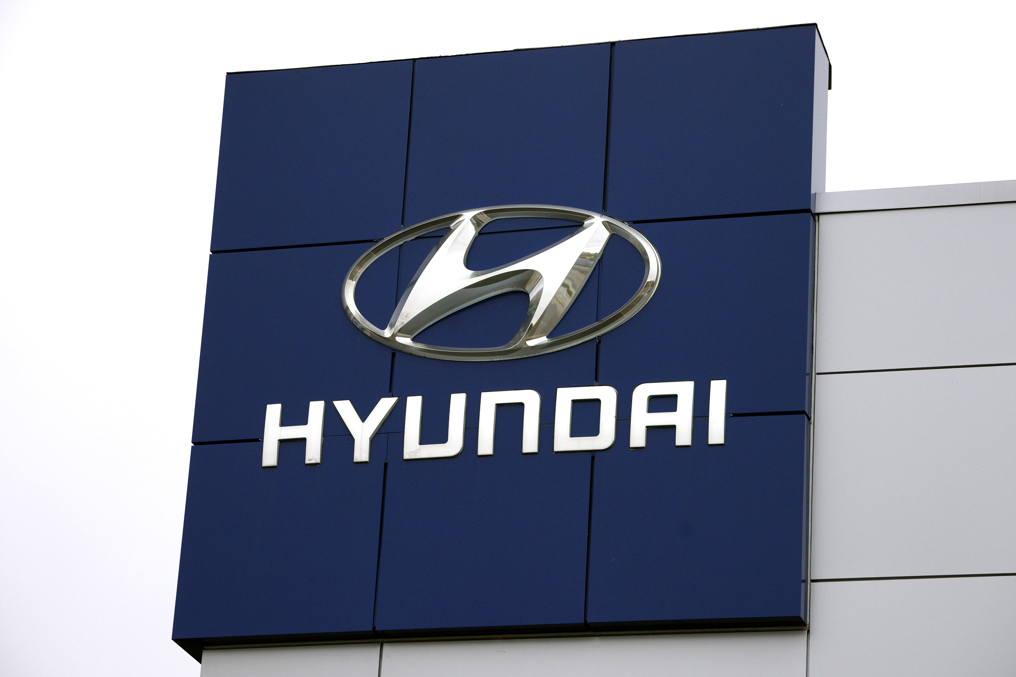 The Hyundai logo is seen outside a Hyundai car dealer in Golden, Colorado, November 3, 2014.