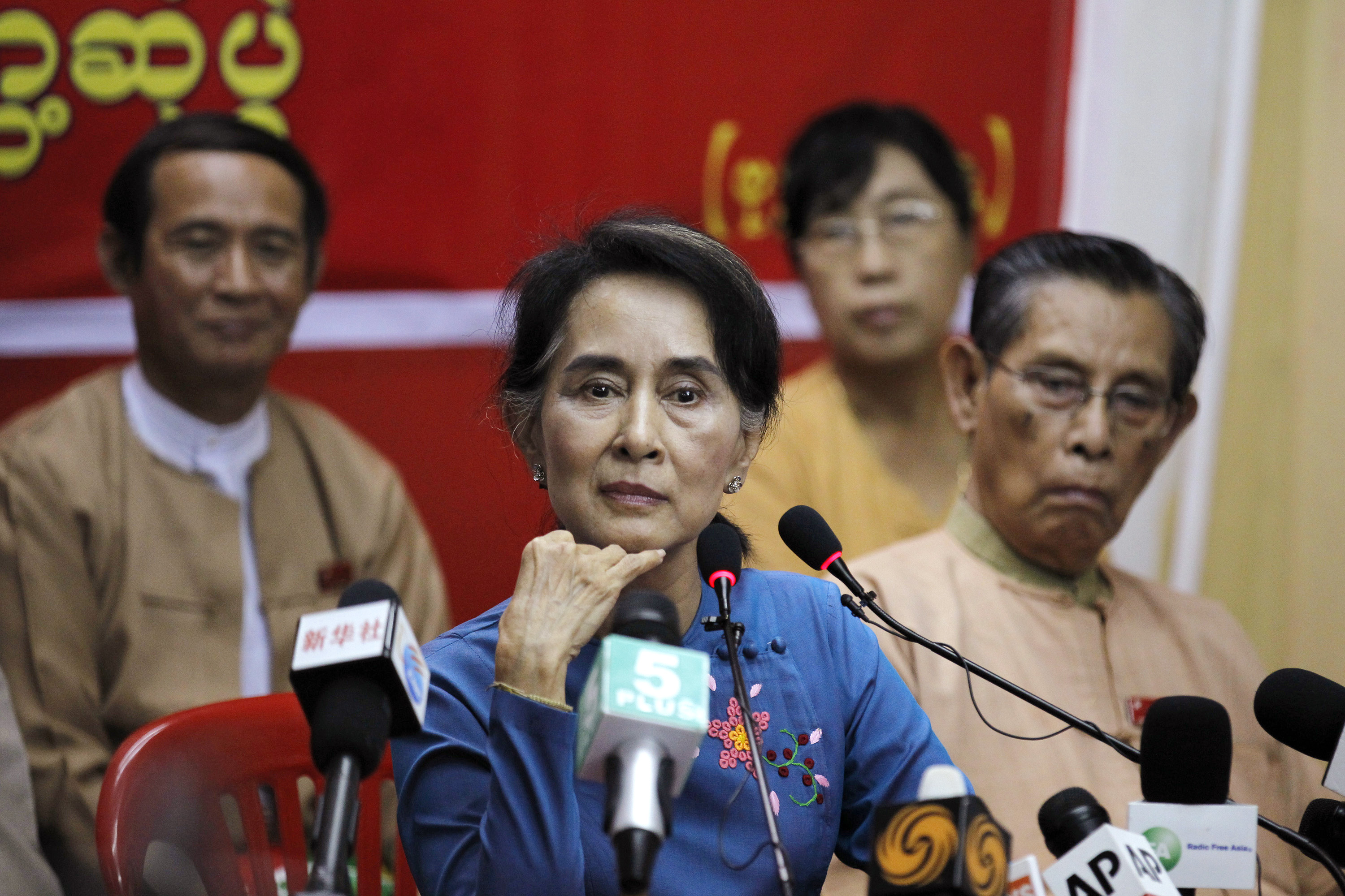 Myanmar's pro-democracy leader Aung San Suu Kyi listens as reporter asks her a question during a news conference at the National League for Democracy party head office in Rangoon on Nov. 5, 2014