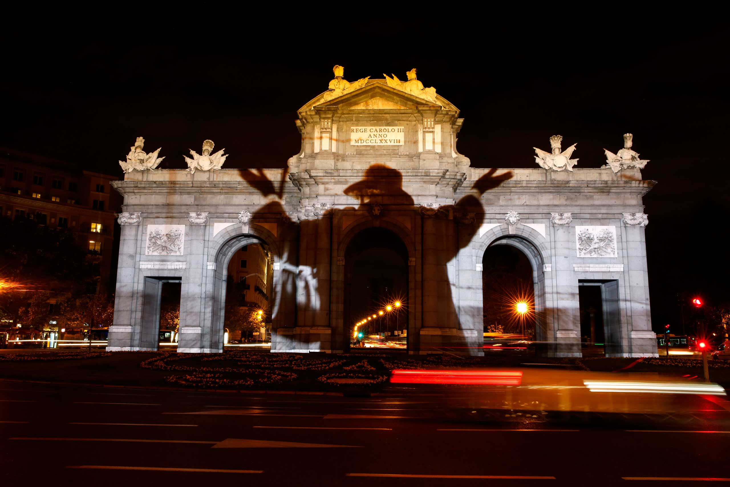 Nov. 7, 2014. A historic image commemorating the former Berlin Wall is projected on Alcala Gate in Madrid. Germany will celebrate the 25th anniversary of the fall of the wall on November 9.