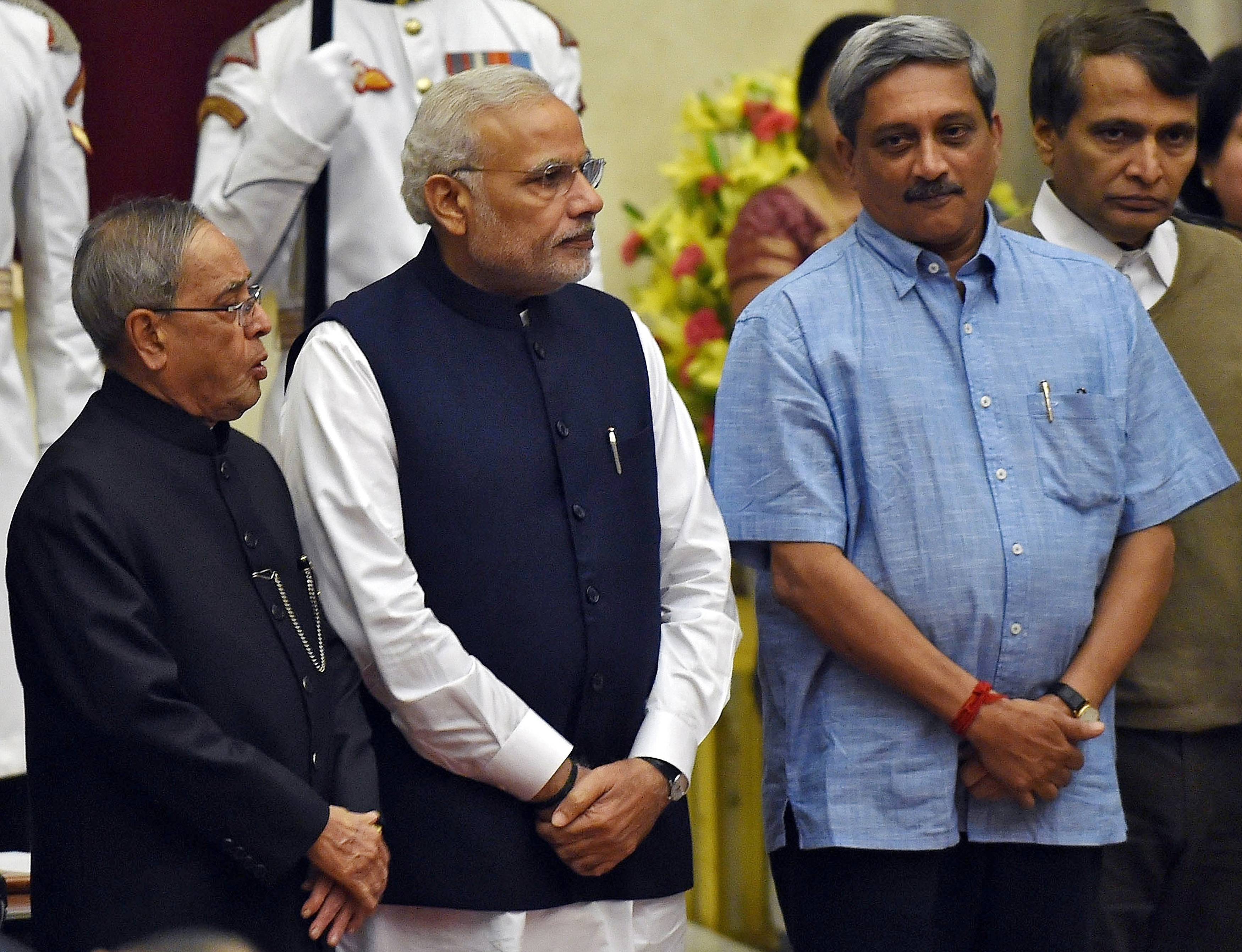 India's President Pranab Mukherjee, Prime Minister Narendra Modi, new cabinet ministers Manohar Parrikar and Suresh Prabhu pose after a swearing-in ceremony at the presidential palace in New Delhi November 9, 2014.