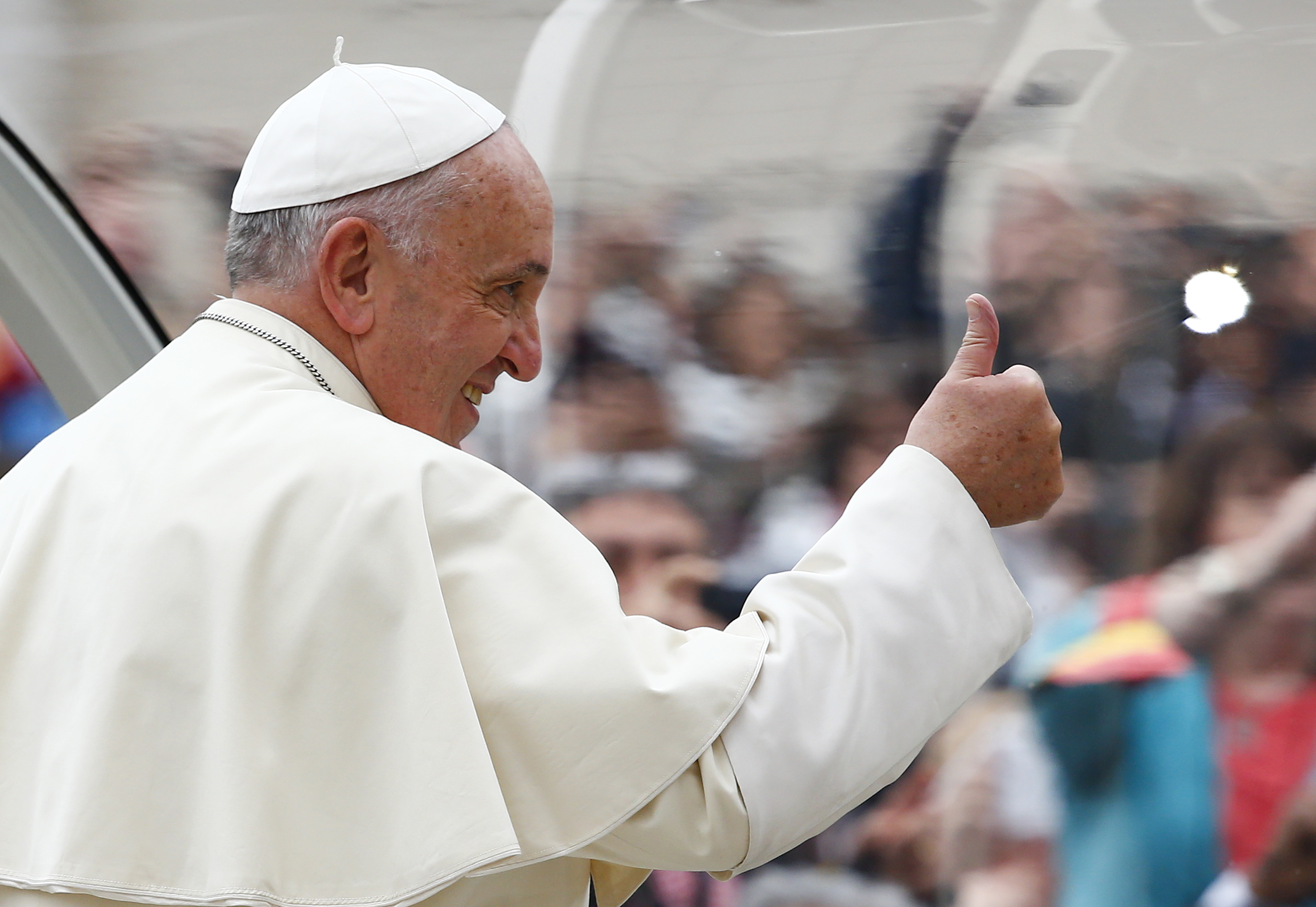 Pope Francis gestures as he arrives to lead his weekly general audience in Saint Peter's Square at the Vatican November 12, 2014.