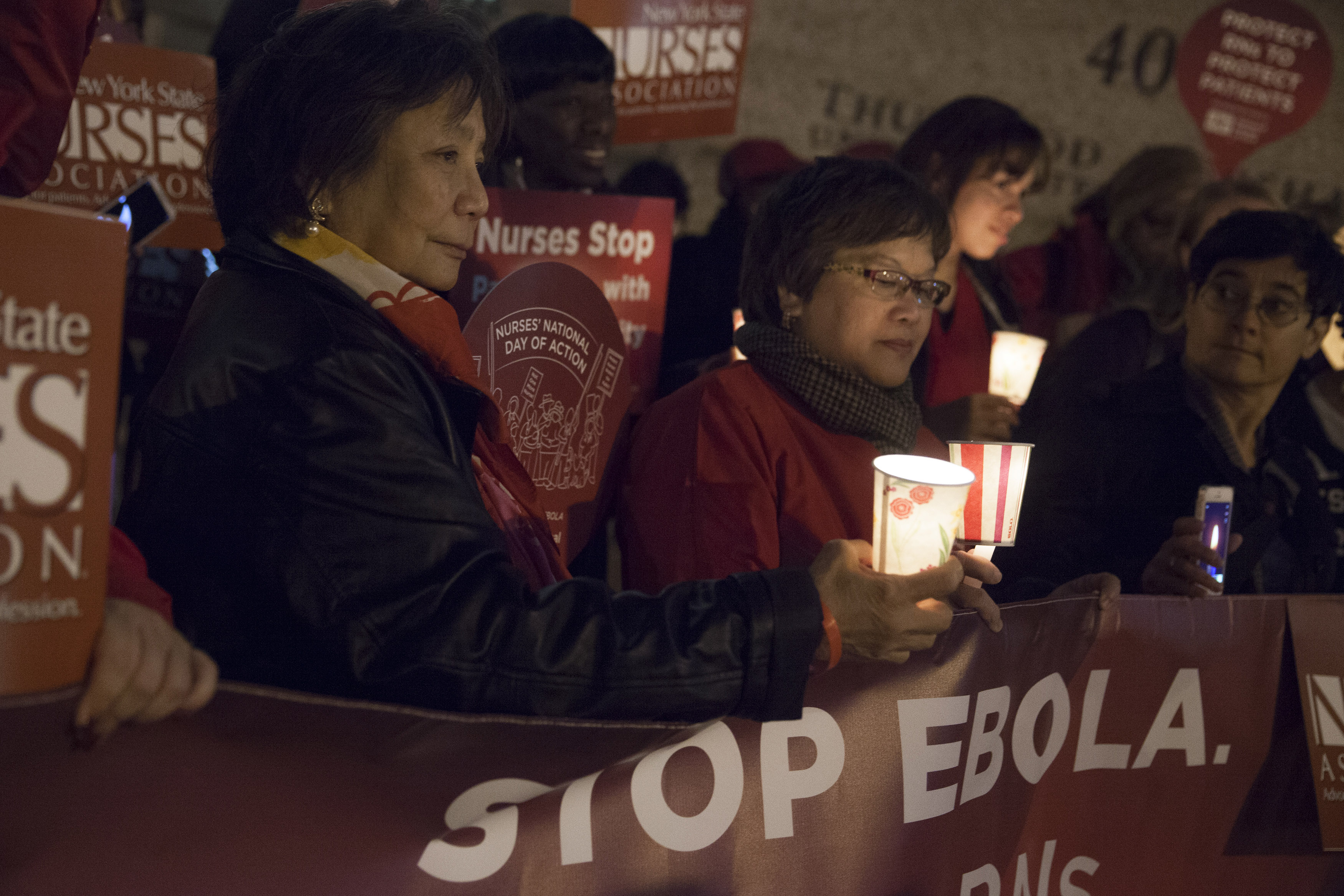 Nurses from the New York State Nurses Association protest for improved Ebola safeguards, part of a national day of action, in New York City November 12, 2014.