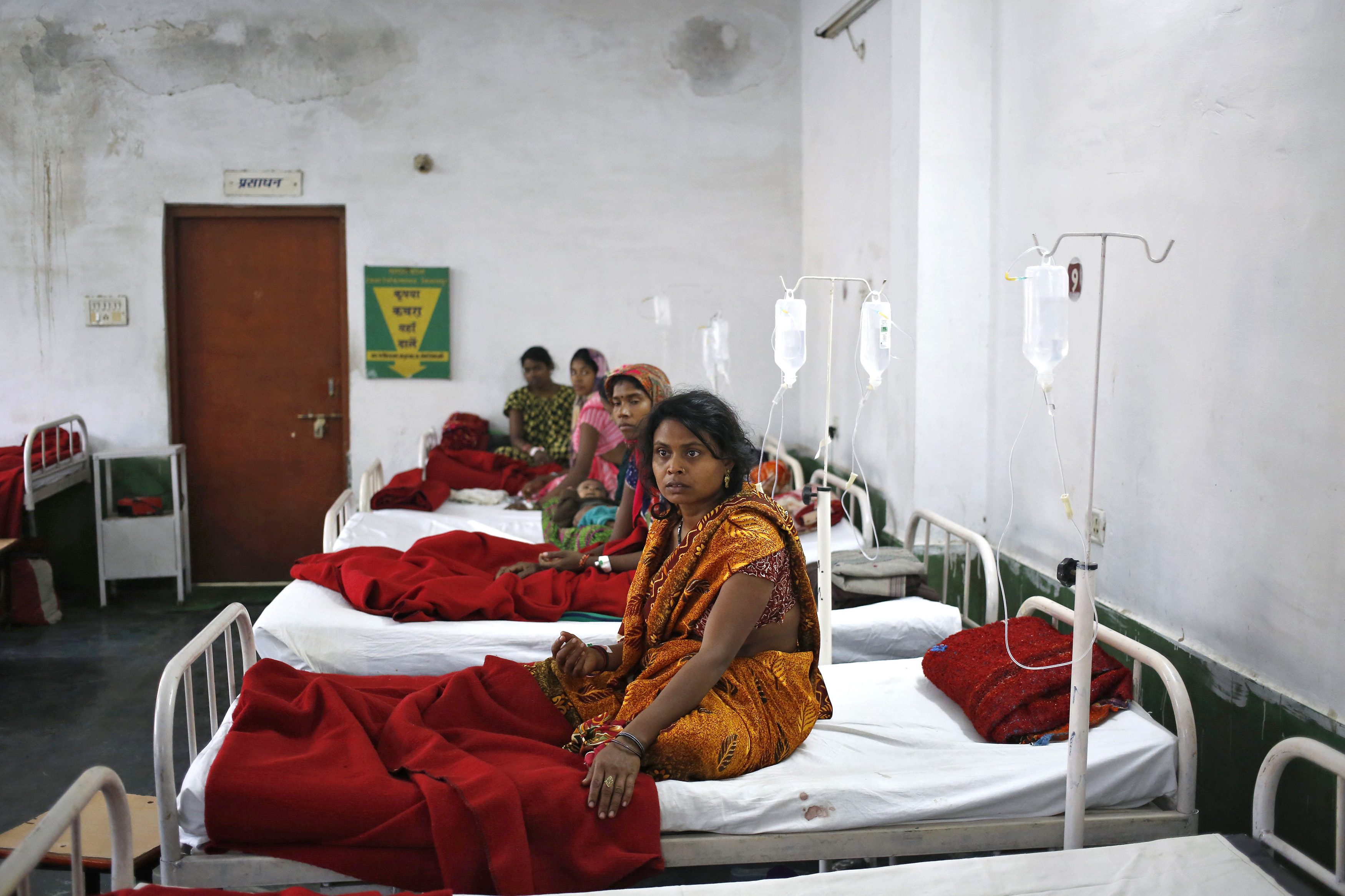 Women, who underwent a sterilization surgery at a government mass-sterilization  camp,  lie in hospital beds for treatment at the Chhattisgarh Institute of Medical Sciences hospital in Bilaspur, in the eastern Indian state of Chhattisgarh, on Nov. 13, 2014