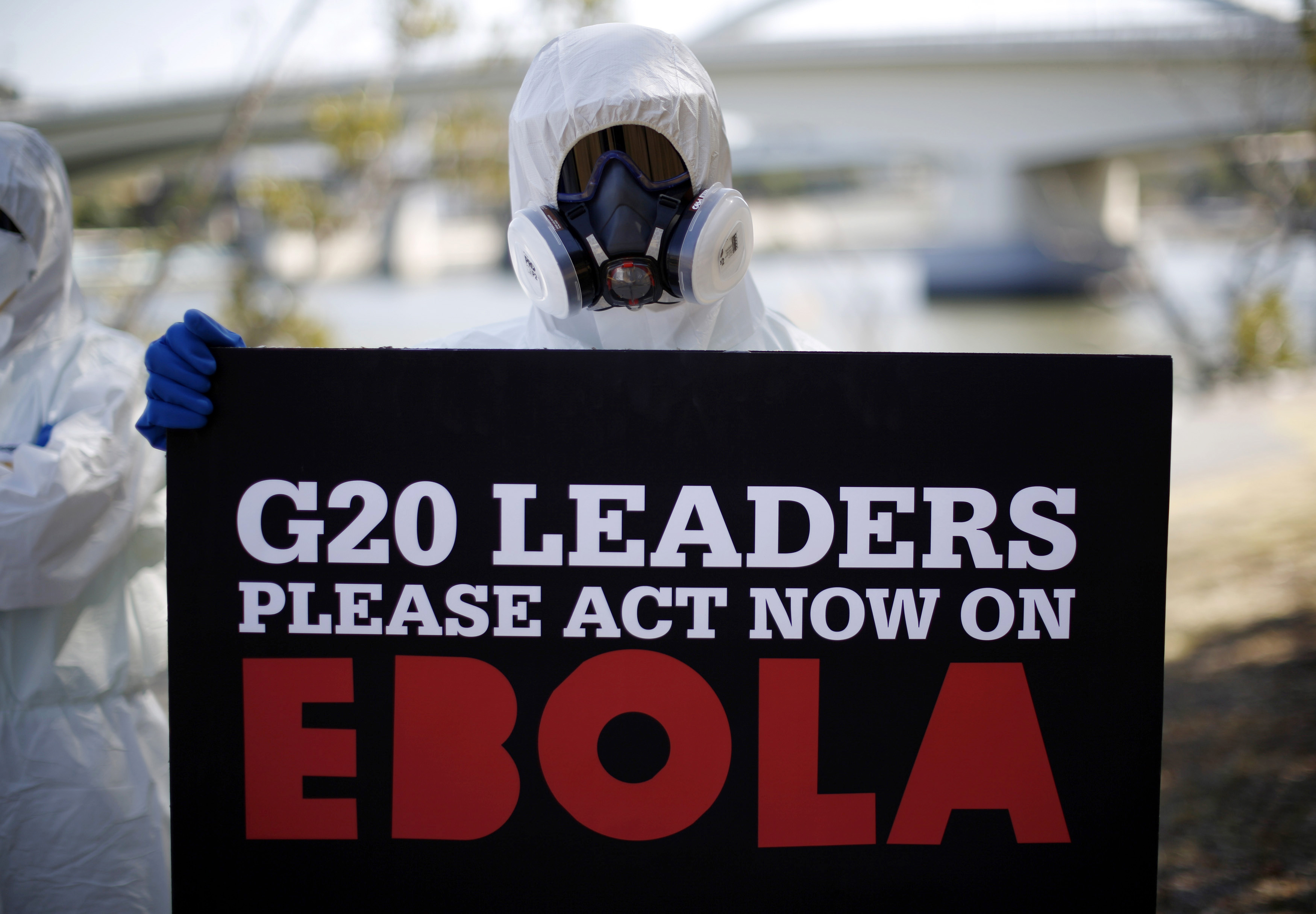 A protester dressed in protective equipment demonstrates, calling for for G20 leaders to address the Ebola issue, near the G20 leaders summit venue in Brisbane Nov. 15, 2014