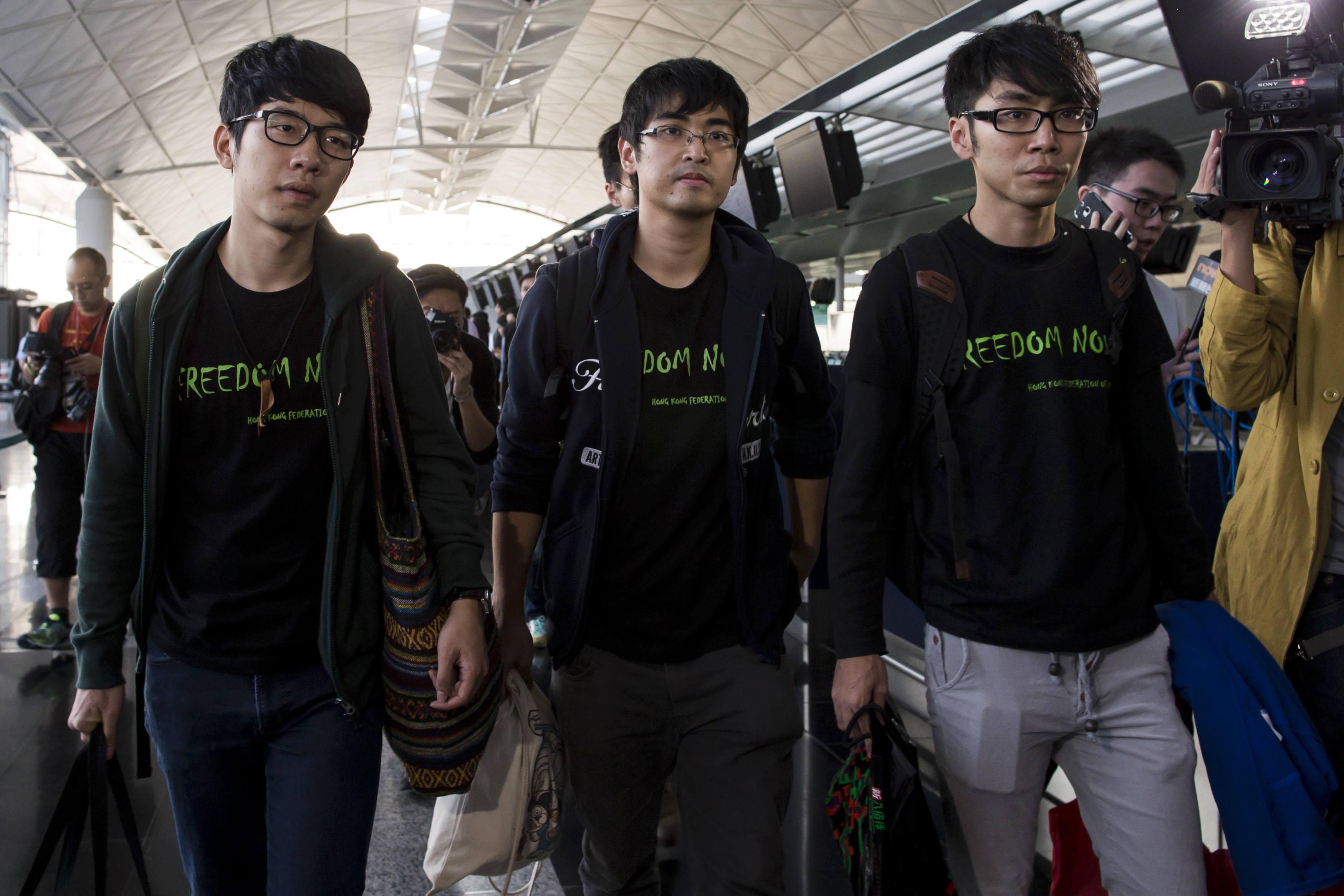 From left: Nathan Law, Alex Chow and Eason Chung of the Hong Kong Federation of Students after being refused to board the plane to Beijing at the Hong Kong International Airport on Nov. 15, 2014