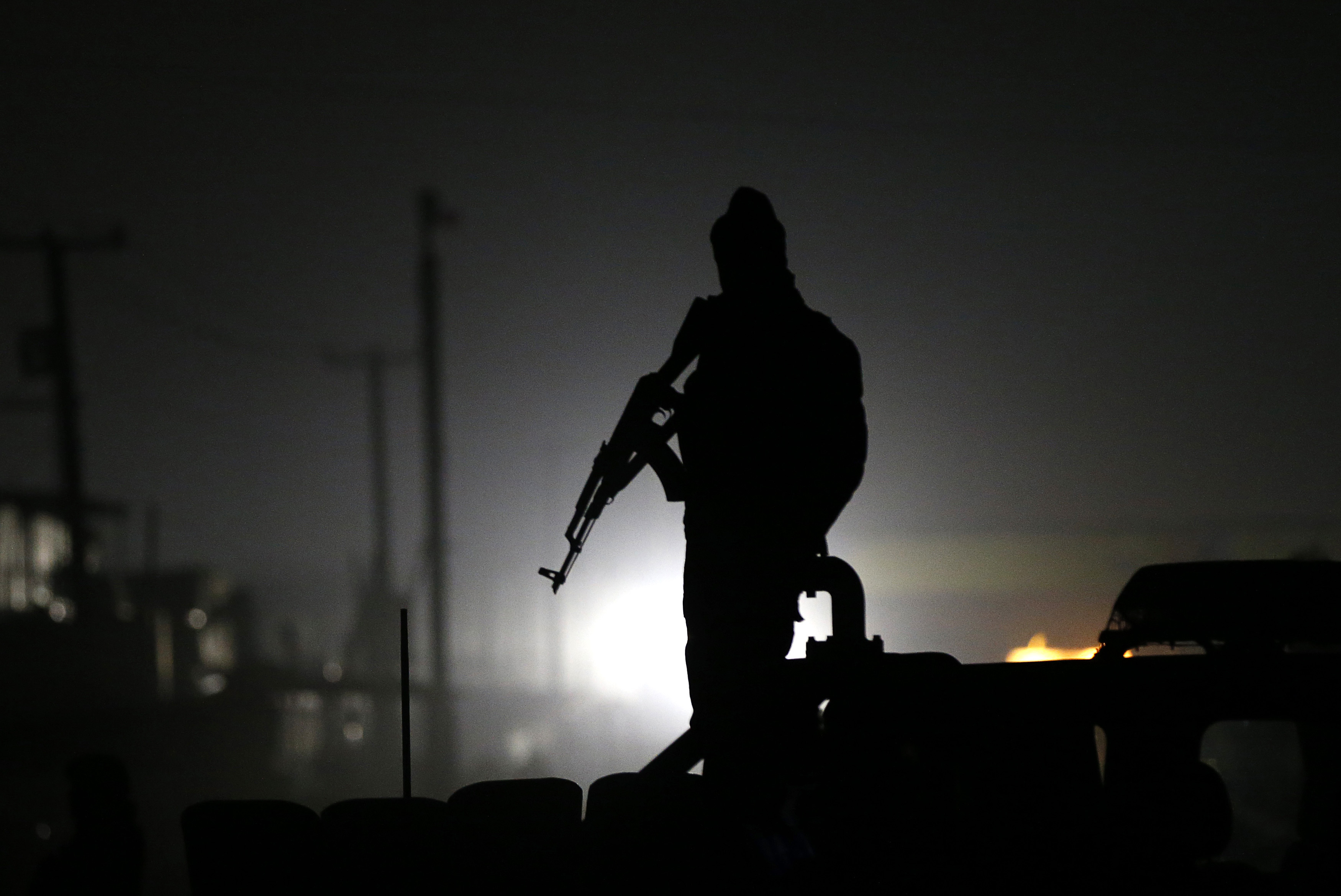 An Afghan policeman keeps watch at the site of a Taliban attack in Kabul on Wednesday.