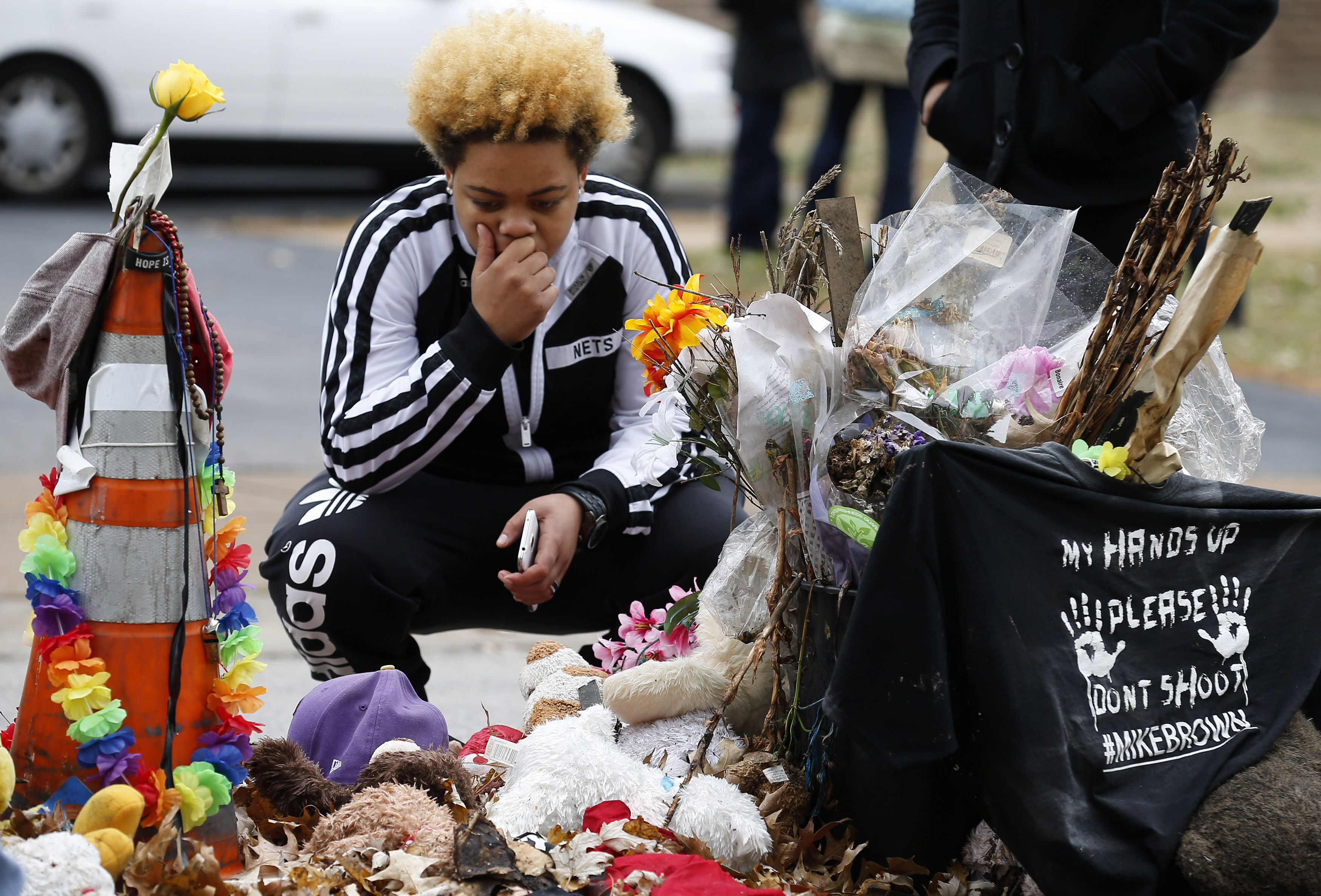 A woman stops to visit the memorial set up where Michael Brown was shot and killed in Ferguson, Missouri, Nov. 22, 2014.
