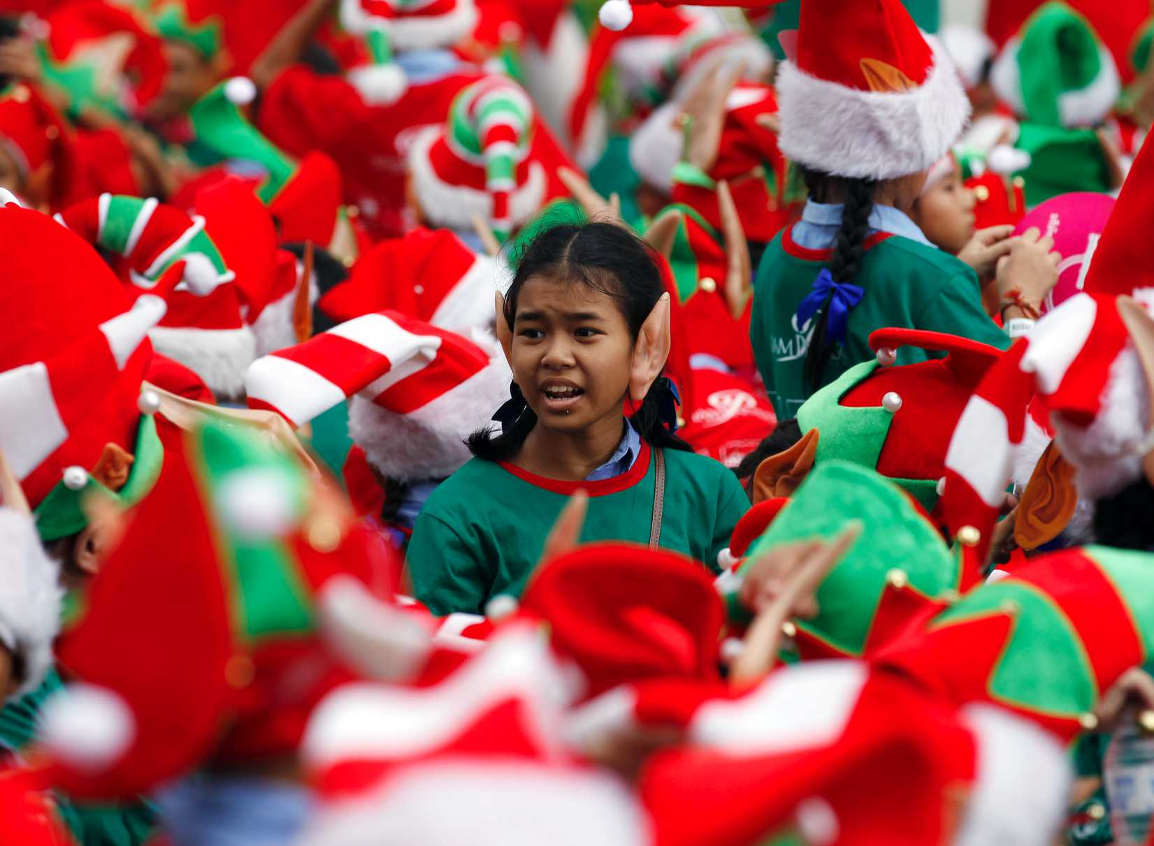 Students gather to break the Guinness World Record for the largest gathering of Christmas elves outside a shopping mall in Bangkok on Nov. 25, 2014