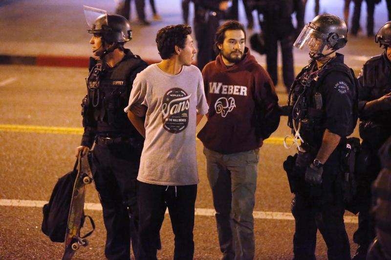 Police detain protesters during a march in Los Angeles on Nov. 26, 2014