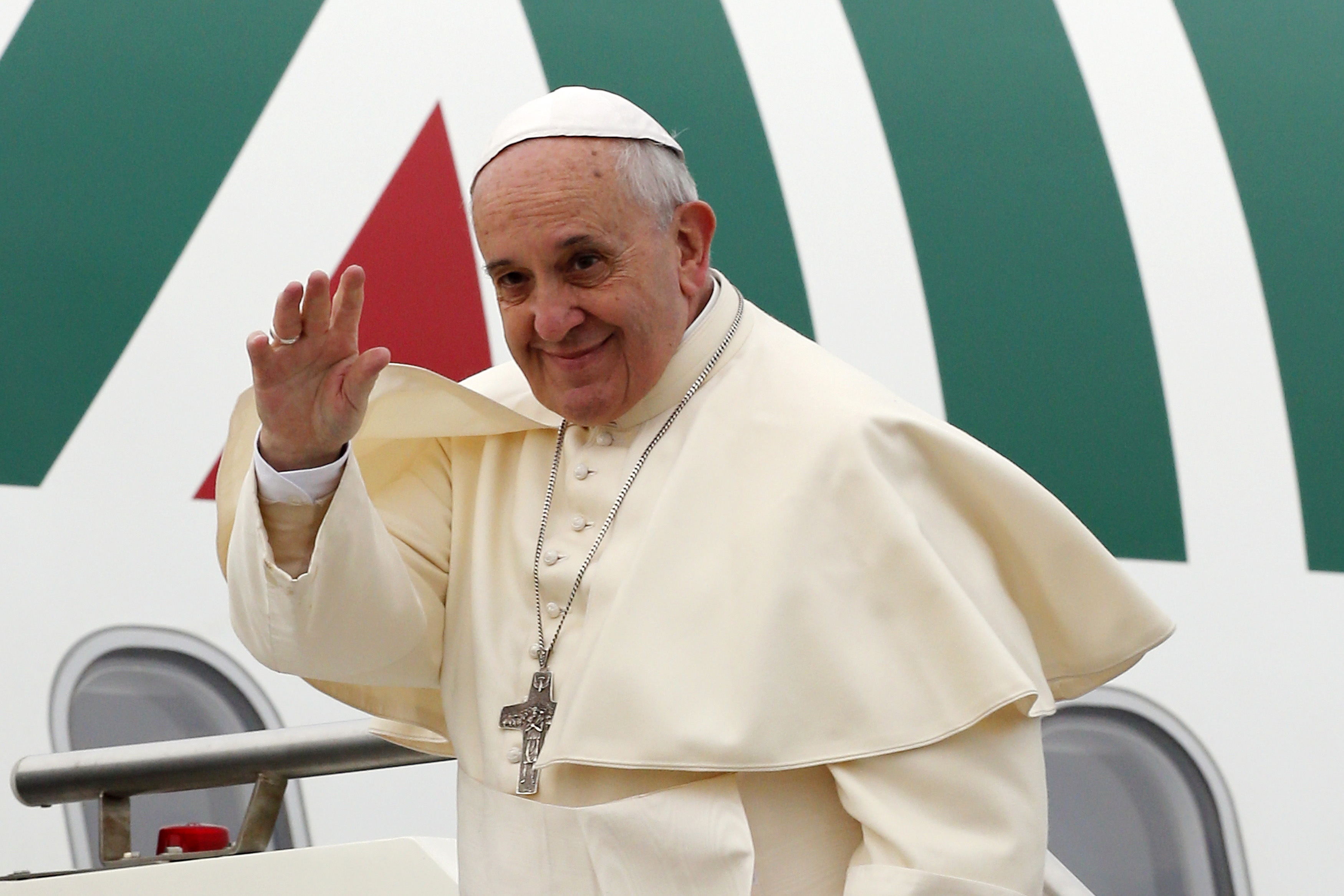 Pope Francis waves as he boards a plane at Fiumicino Airport in Rome Nov. 28, 2014