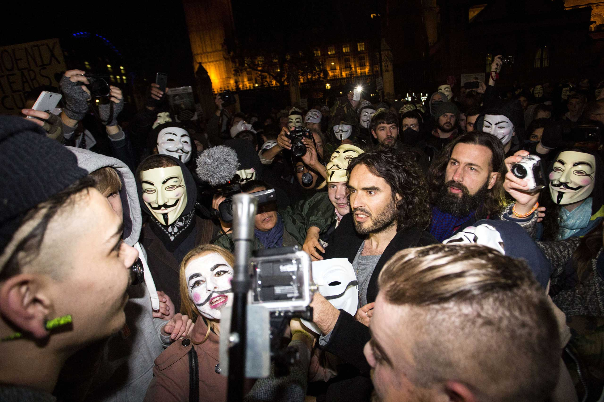 British comedian Russell Brand joins anti-capitalist protesters during the  Million Masks March  in London on Nov. 5, 2014.