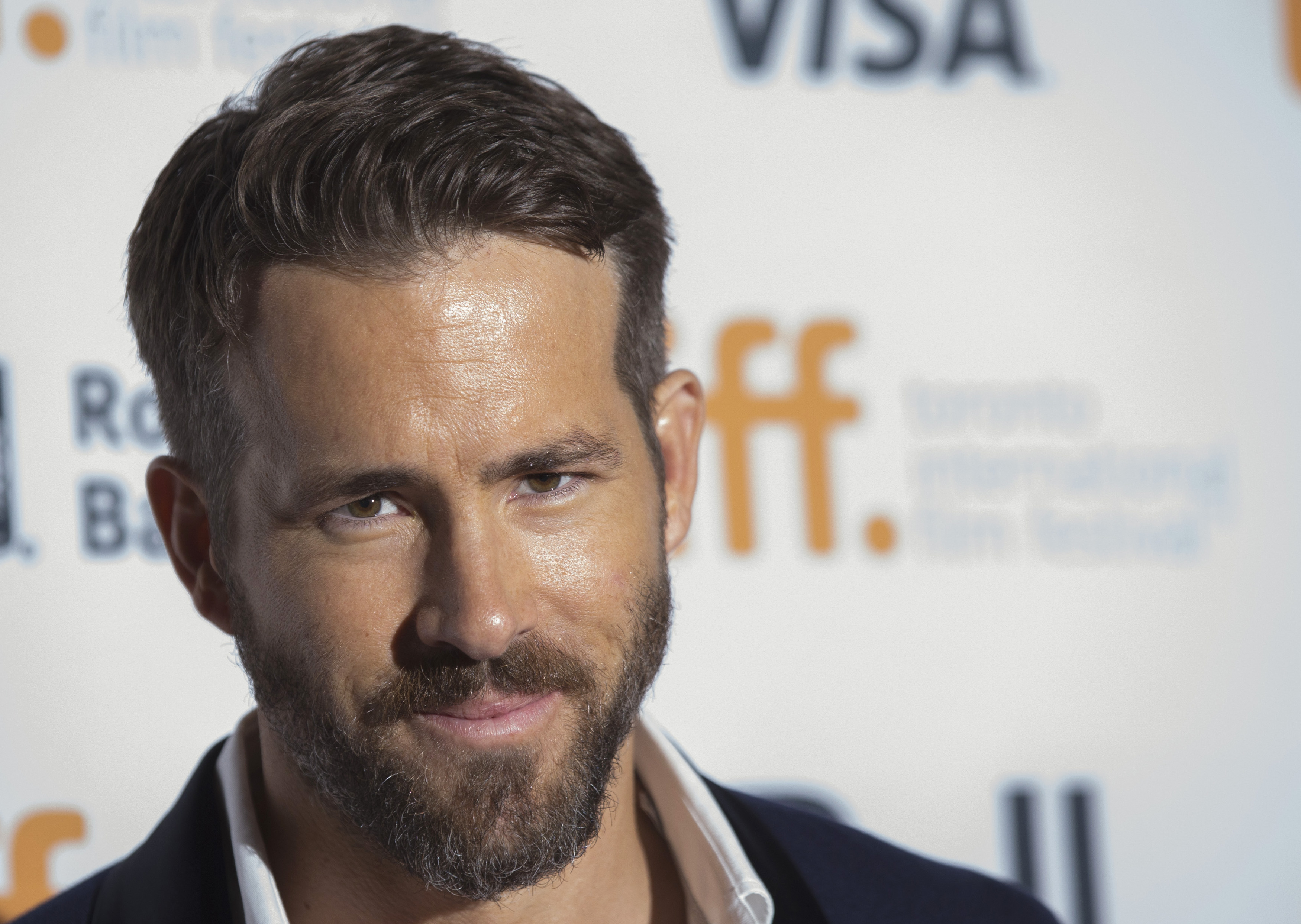 Cast member Ryan Reynolds arrives for the  The Voices  gala during the Toronto International Film Festival in Toronto on Sept. 11, 2014.